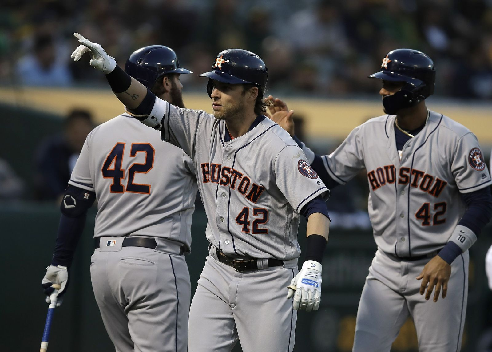 Houston Astros' Josh Reddick, center, celebrates after hitting a two-run home run off Oakland Athletics' Marco Estrada in the second inning of a baseball game, Tuesday, April 16, 2019, in Oakland, Calif. (AP Photo/Ben Margot)
