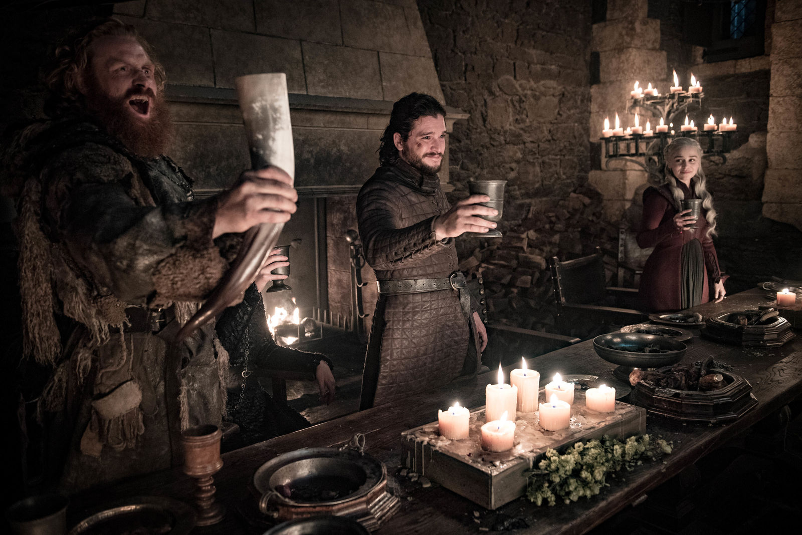 "This image released by HBO shows Kristofer Hivju, from left, Kit Harington and Emilia Clarke in a scene from ""Game of Thrones.""  ""Game of Thrones,"" ""Veep"" and ""The Big Bang Theory,"" three major series that wrapped last season, will find out with Tuesday's nominations if they have one more chance at Emmy gold. (Helen Sloan/HBO via AP)"