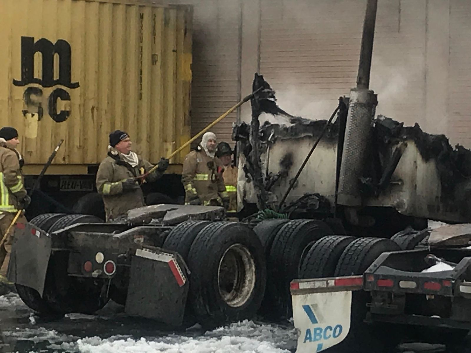 A semi cab caught fire at a building off Fisher Road Tuesday morning Jan. 22, 2019. (WSYX/WTTE)