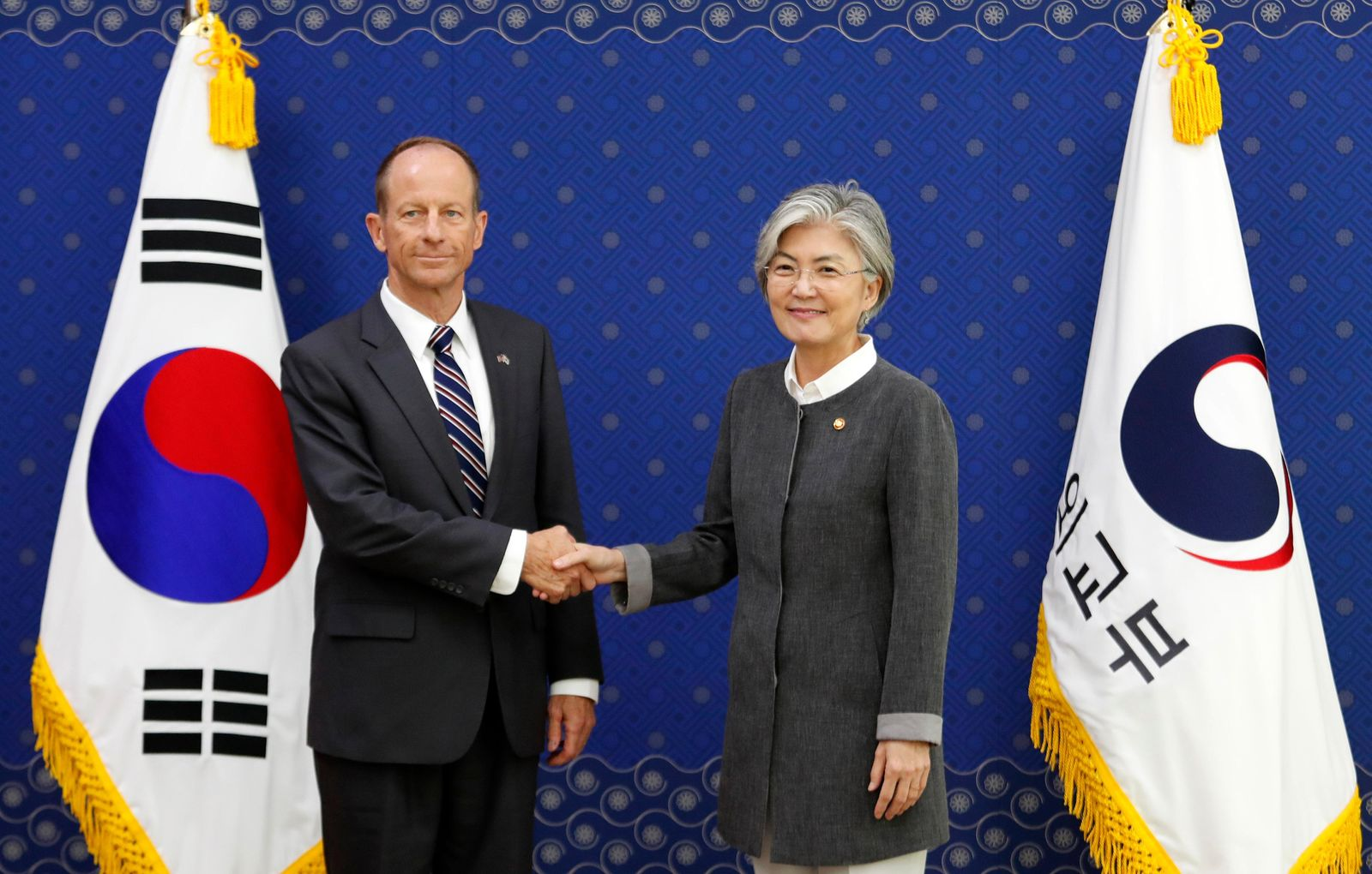 South Korean Foreign Minister Kang Kyung-wha, right, shakes hands with David Stilwell, U.S Assistant Secretary of State for the Bureau of East Asian and Pacific Affairs, during a meeting at the foreign ministry in Seoul, South Korea, Wednesday, July 17, 2019. (AP Photo/Ahn Young-joon. Pool)