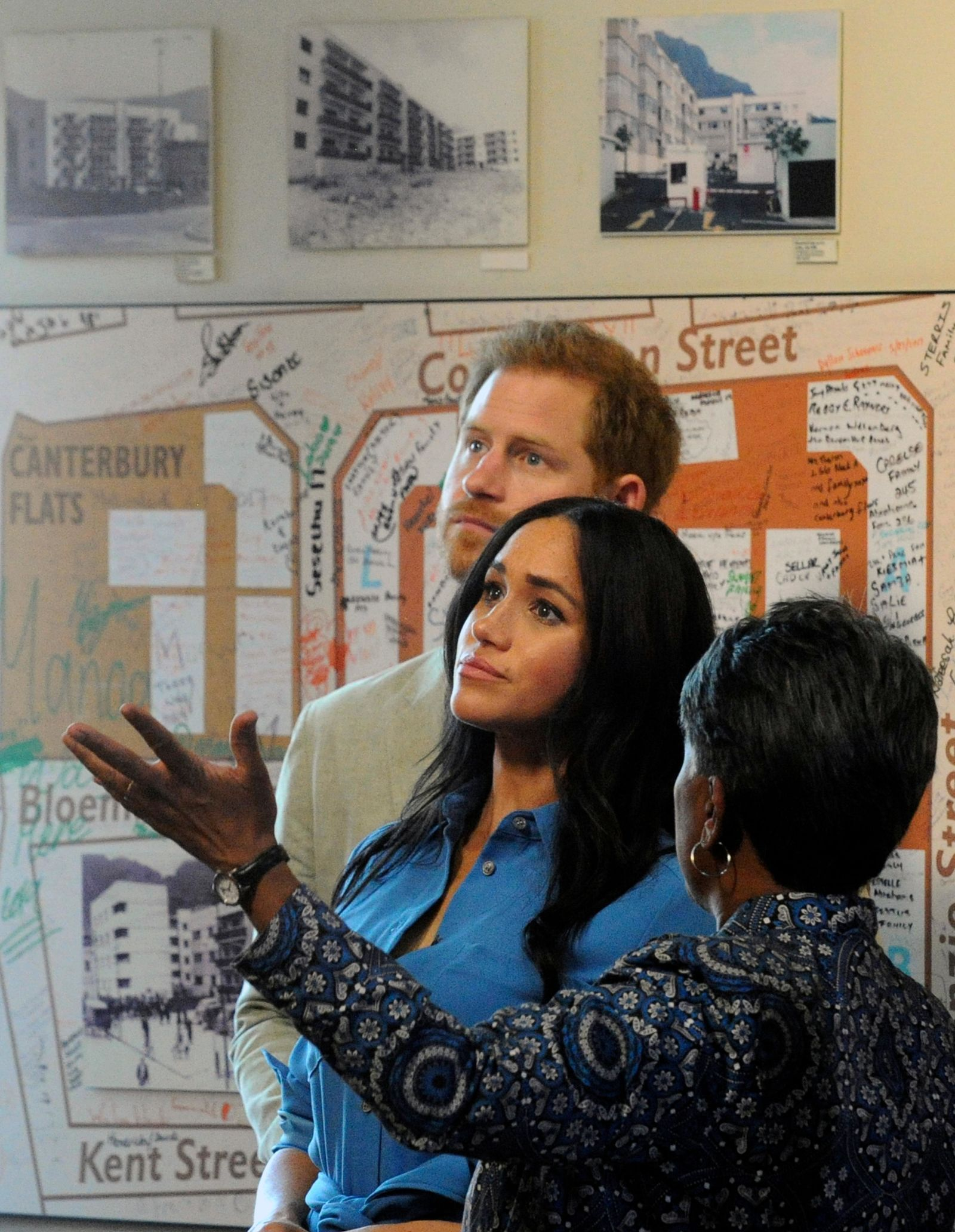 FILE - In this Monday, Sept, 23, 2019 file photo, Britain's Prince Harry and Meghan, Duchess of Sussex are given a guided tour of the District Six Museum in Cape Town, South Africa. (Henk Kruger/Pool via AP, File)