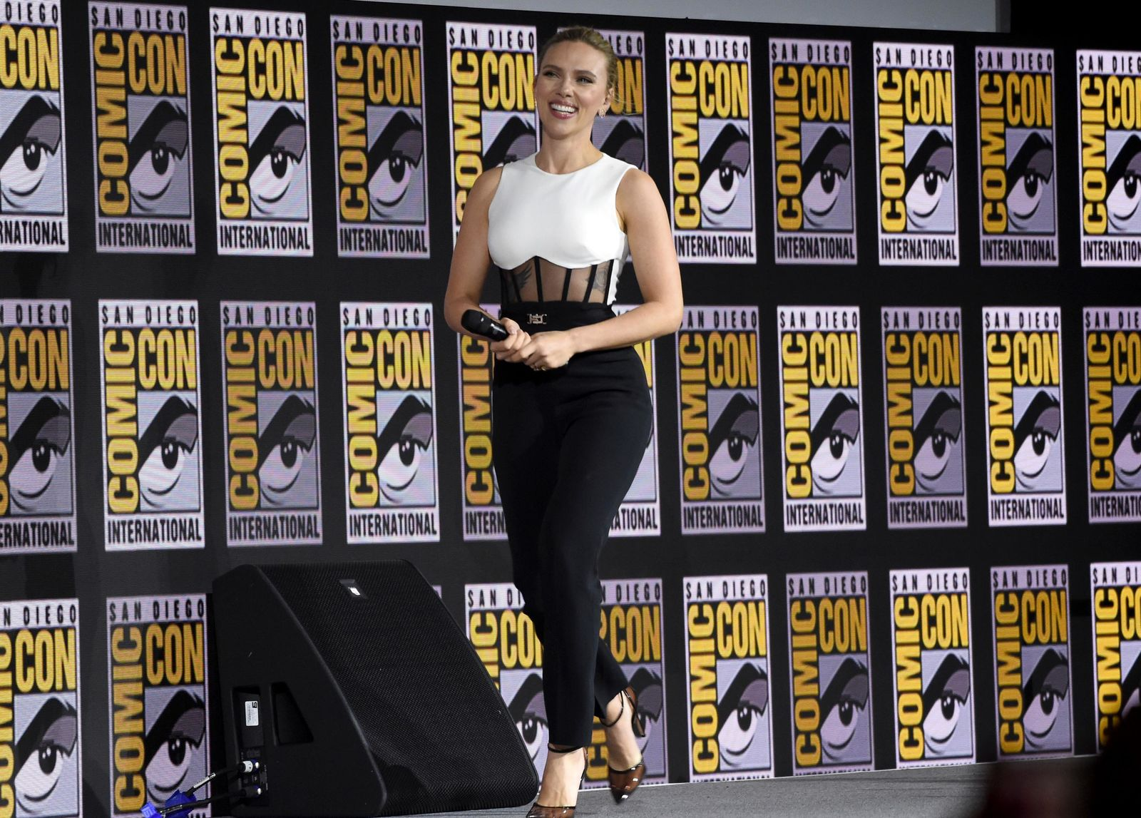 "Scarlett Johansson walks on stage during the ""Black Widow"" portion of the Marvel Studios panel on day three of Comic-Con International on Saturday, July 20, 2019, in San Diego. (Photo by Chris Pizzello/Invision/AP)"