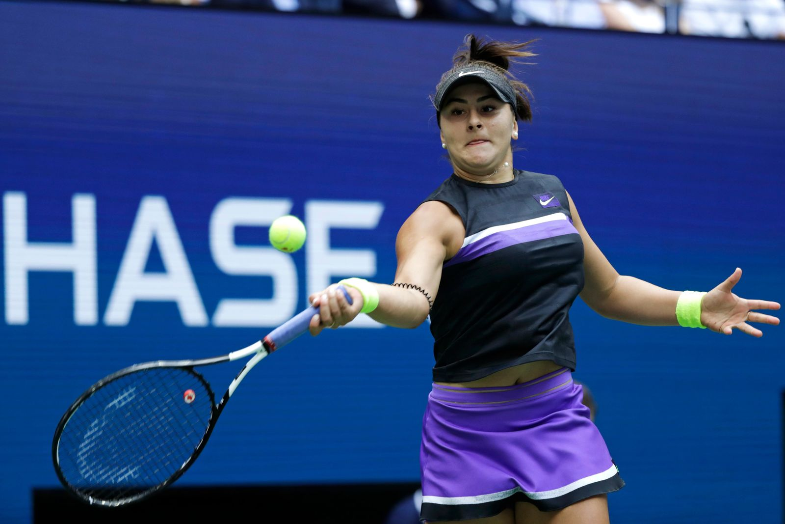 Bianca Andreescu, of Canada, returns a shot to Serena Williams, of the United States, during the women's singles final of the U.S. Open tennis championships Saturday, Sept. 7, 2019, in New York. (AP Photo/Adam Hunger)