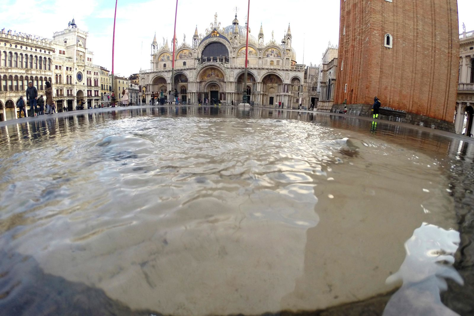 Water starts rising again in St. Mark square in Venice, Italy, Saturday, Nov. 16, 2019. High tidal waters returned to Venice on Saturday, four days after the city experienced its worst flooding in 50 years. (AP Photo/Luca Bruno)
