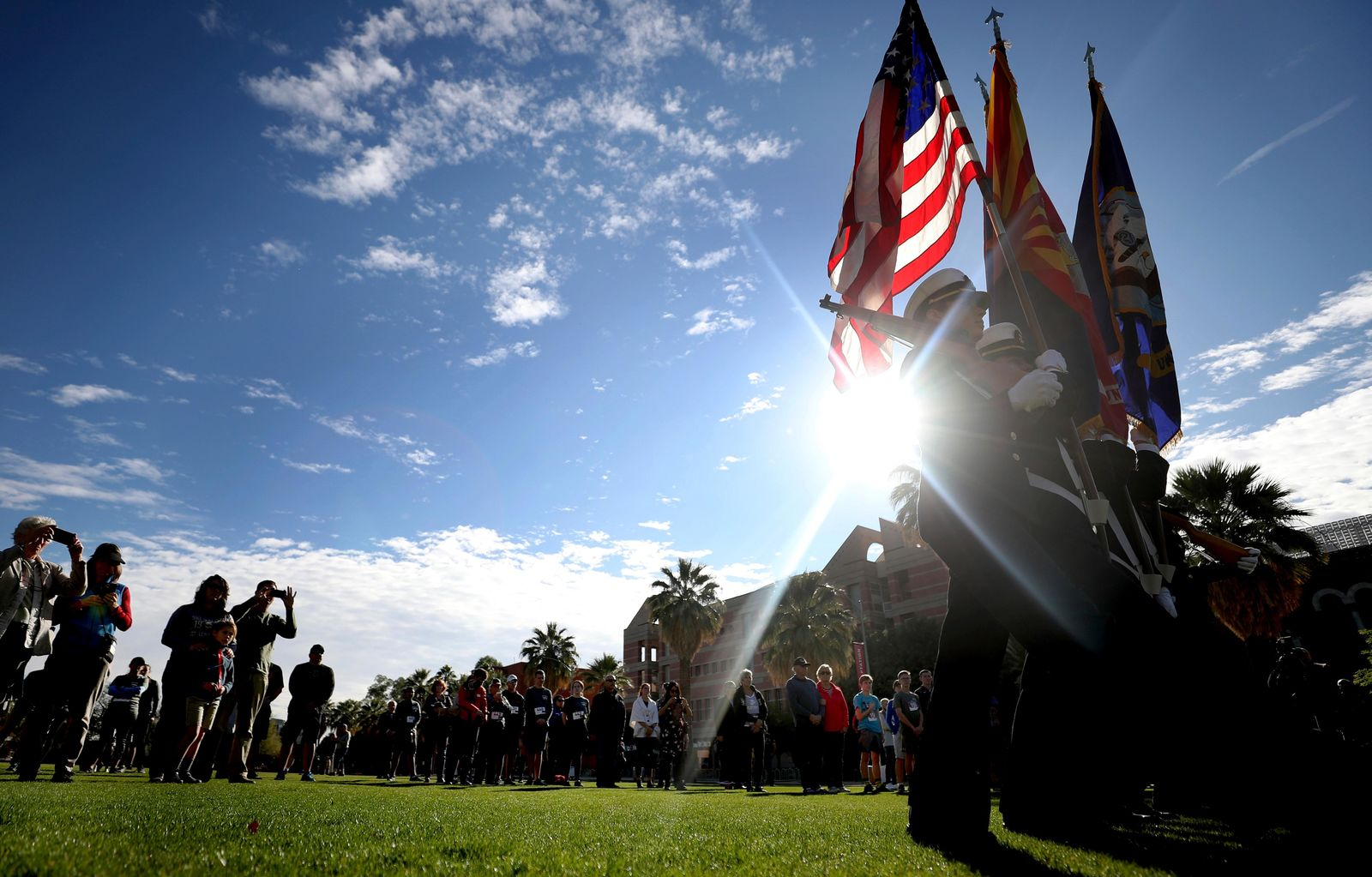 The University of Arizona Navy ROTC color guard present the colors during ceremonies on the school's mall commemorating the USS Arizona and Pearl Harbor Day, Tucson, Ariz., Saturday, Dec. 7, 2019. The 1941 aerial assault killed more than 2,300 U.S. troops. Nearly half — or 1,177 — were Marines and sailors serving on the USS Arizona, a battleship moored in the harbor. The vessel sank within nine minutes of being hit, taking most of its crew down with it. (Kelly Presnell/Arizona Daily Star via AP)
