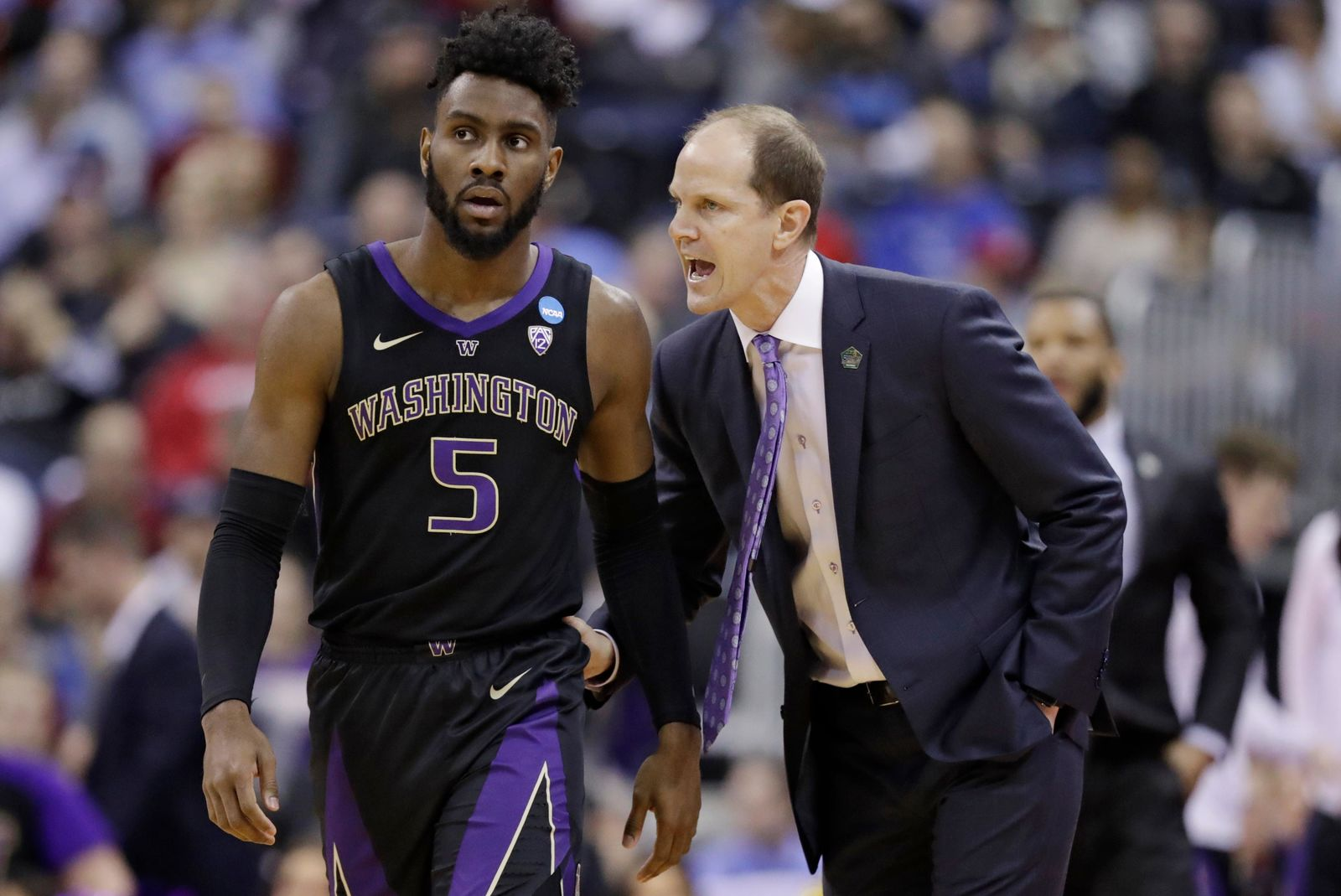 Washington head coach Mike Hopkins, right, talks with Jaylen Nowell in the first half against Utah State during a first round men's college basketball game in the NCAA Tournament in Columbus, Ohio, Friday, March 22, 2019. (AP Photo/Tony Dejak)
