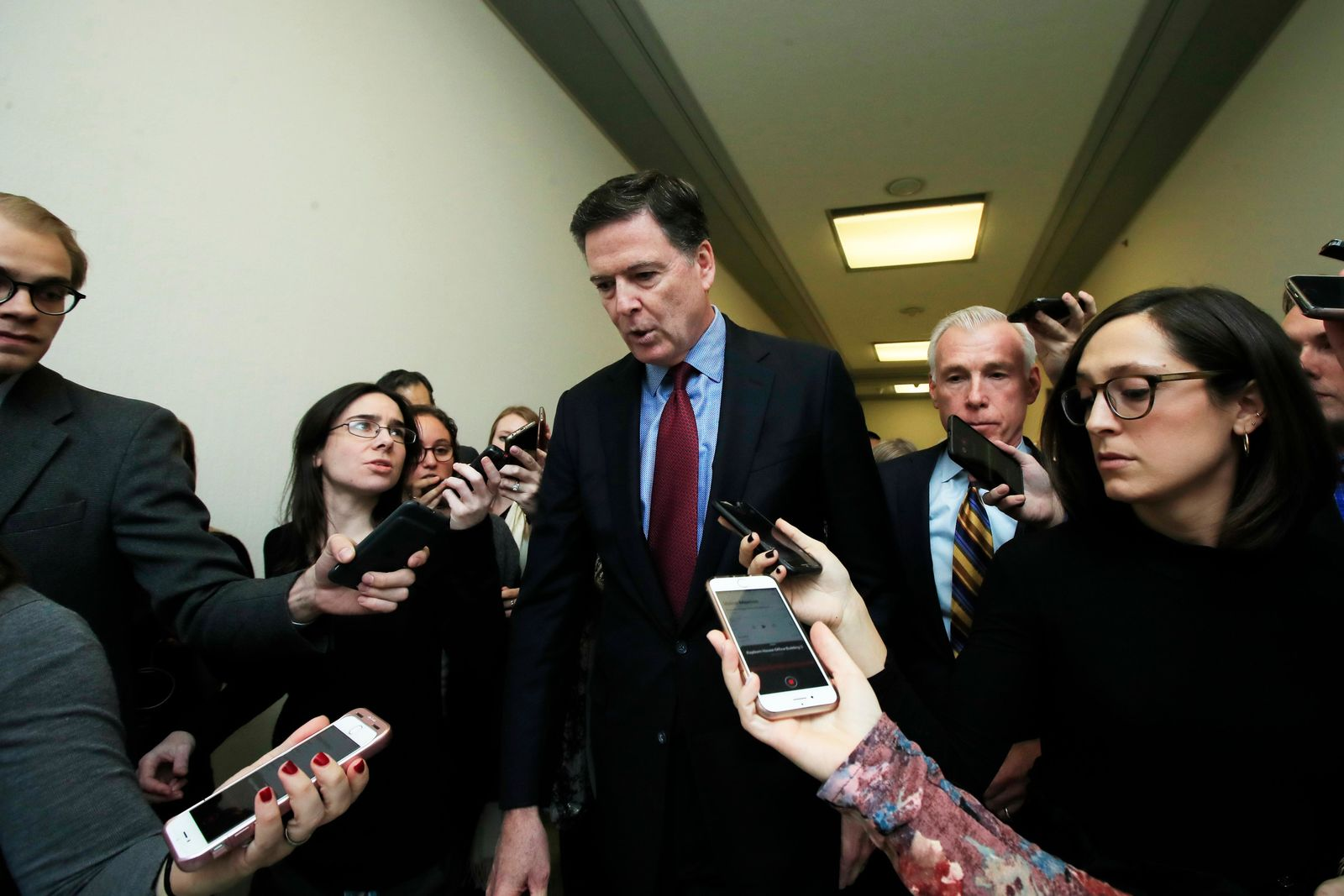 Former FBI Director James Comey speaks to reporters after testifying under subpoena behind closed doors before the House Judiciary and Oversight Committee on Capitol Hill in Washington, Friday, Dec. 7, 2018. (AP Photo/Manuel Balce Ceneta)