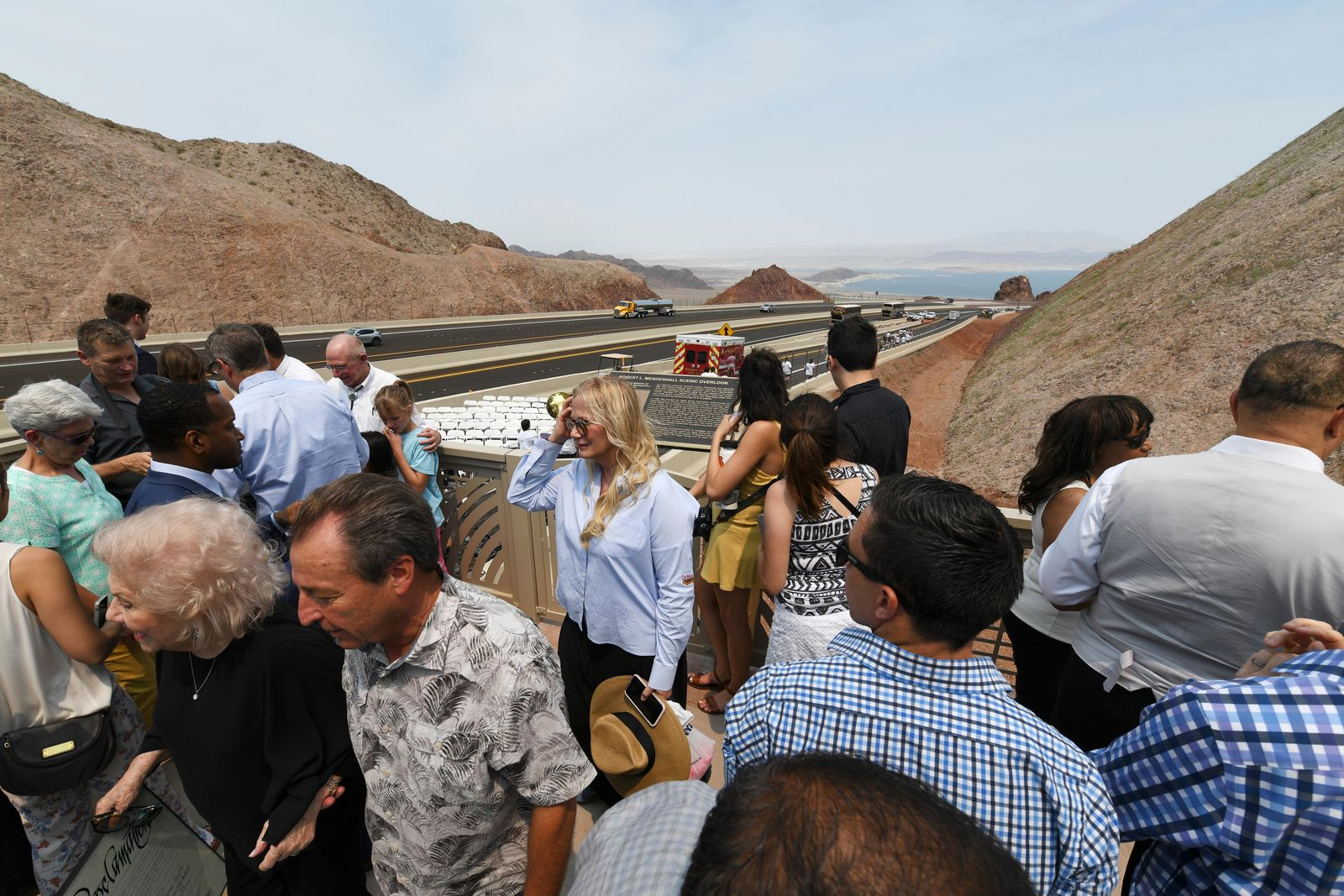Attendees take in the view from the Robert Mendenhall Scenic Overlook during the grand opening of a new section of Interstate 11 Thursday, August 9, 2018, in Boulder City. The section, also referred to as the Boulder City Bypass, marks the official start of the I-11 project between Las Vegas and Phoenix. CREDIT: Sam Morris/Las Vegas News Bureau