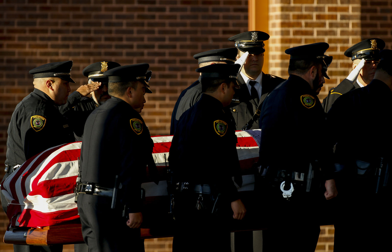 Pallbearers carry the casket of Houston Police Sgt. Christopher Brewster, Thursday, Dec. 12, 2019, at Grace Church Houston in Houston. Brewster, 32, was gunned down Saturday evening, Dec. 7, while responding to a domestic violence call in Magnolia Park. Police arrested 25-year-old Arturo Solis that night in the shooting death. Solis faces capital murder charges. (Godofredo A. Vásquez/Houston Chronicle via AP)