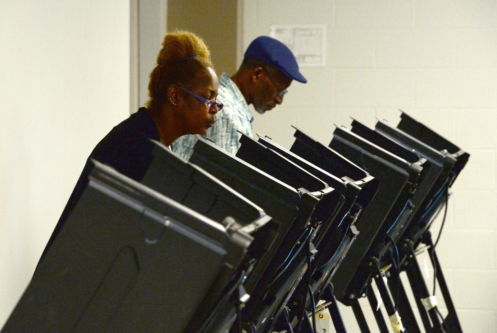 Tanya Archie-Younge, 56 and her husband, Jesse Younge, 62, cast their ballots at Precinct #25 at the West Charlotte Recreation Center Tuesday, September 10, 2019.{ } (John D. Simmons/The Charlotte Observer via AP)