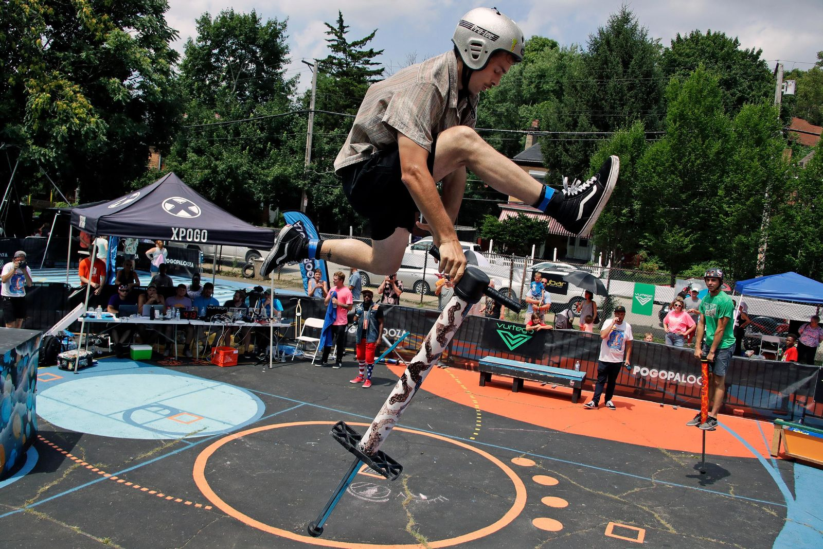 Dalton Smith, 22, of Nashville, Tenn., performs during during Pogopalooza, The World Championships of Pogo in Wilkinsburg, Pa., Saturday, July 20, 2019. (AP Photo/Gene J. Puskar)
