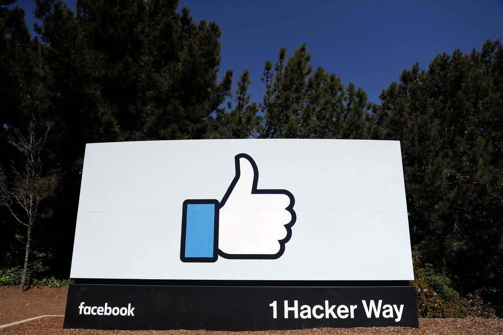 FILE- This March 28, 2018, file photo shows the Facebook logo at the company's headquarters in Menlo Park, Calif. A Wall Street Journal report says that the FTC has voted this week to approve a fine of about $5 billion for Facebook over privacy violations. The report Friday, July 12, 2019, cites an unnamed person familiar with the matter. (AP Photo/Marcio Jose Sanchez, File)