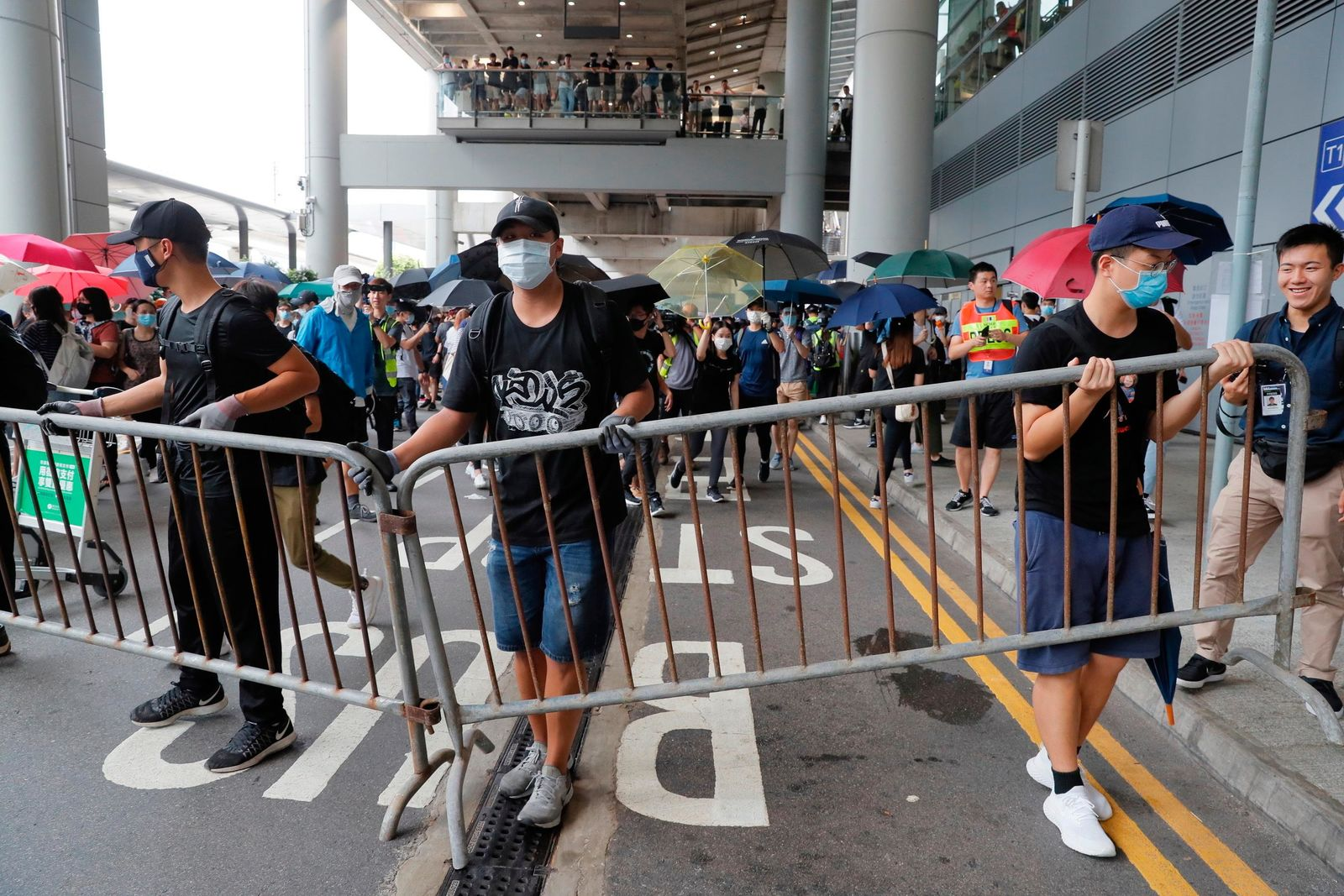 Pro-democracy protestors gather outside the airport in, Hong Kong, Sunday, Sept.1, 2019. (AP Photo/Kin Cheung)