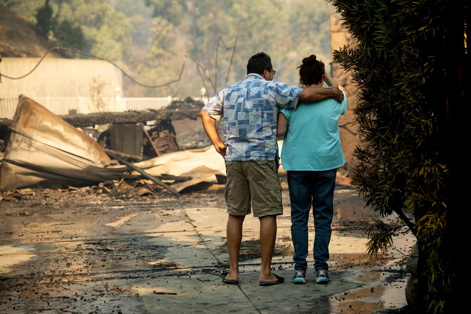 Eyed Jarjour, left, comforts a neighbor who lost her Jolette Ave. home to the Saddleridge Fire on Friday, Oct. 11, 2019, in Granada Hills, Calif. (AP Photo/Noah Berger)