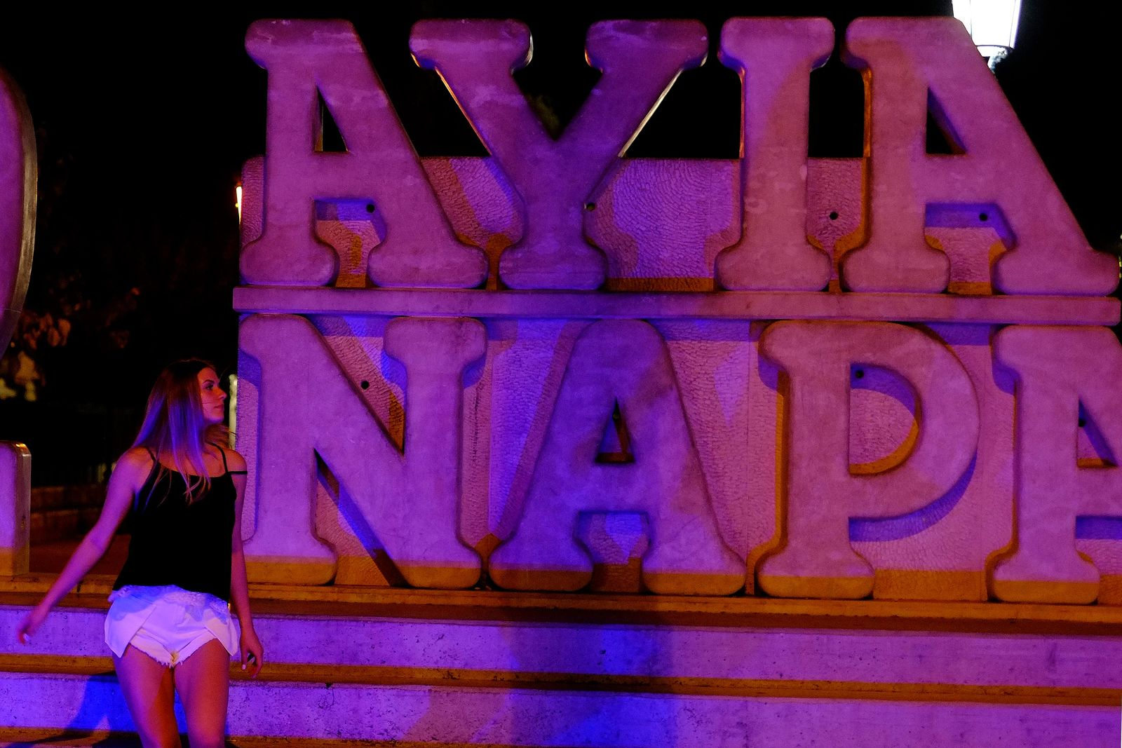 "A tourist walks at a sculpture that read ""I Love Ayia Napa"" after pose for photos in the southeast resort of Ayia Napa in the easter Mediterranean island of Cyprus late Wednesday, July 17, 2019.{ } (AP Photo/Petros Karadjias)"