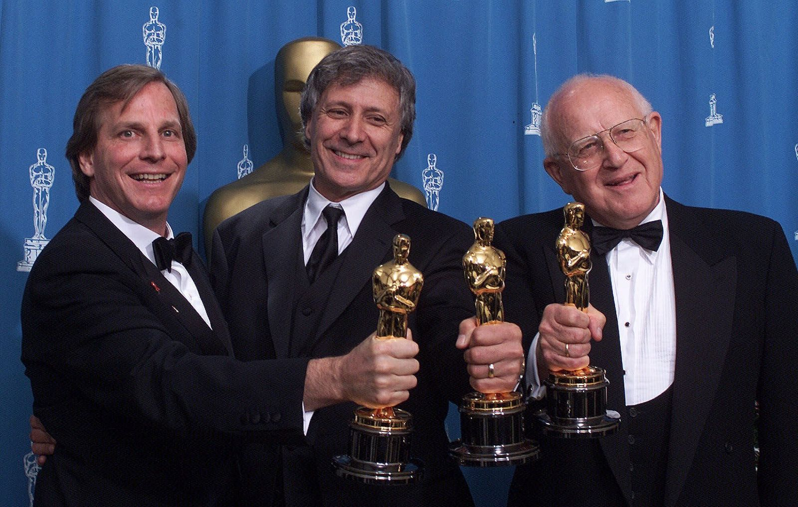 "FILE - In this Sunday, March 25, 2001 file photo, from left: Douglas Wick, David Franzoni and Branko Lustig hold their Oscars backstage at the Shrine Auditorium in Los Angeles, after ""Gladiator"" was honored as best picture of the year by the Academy of Motion Pictures Arts & Sciences. (AP Photo/Richard Drew, file)"