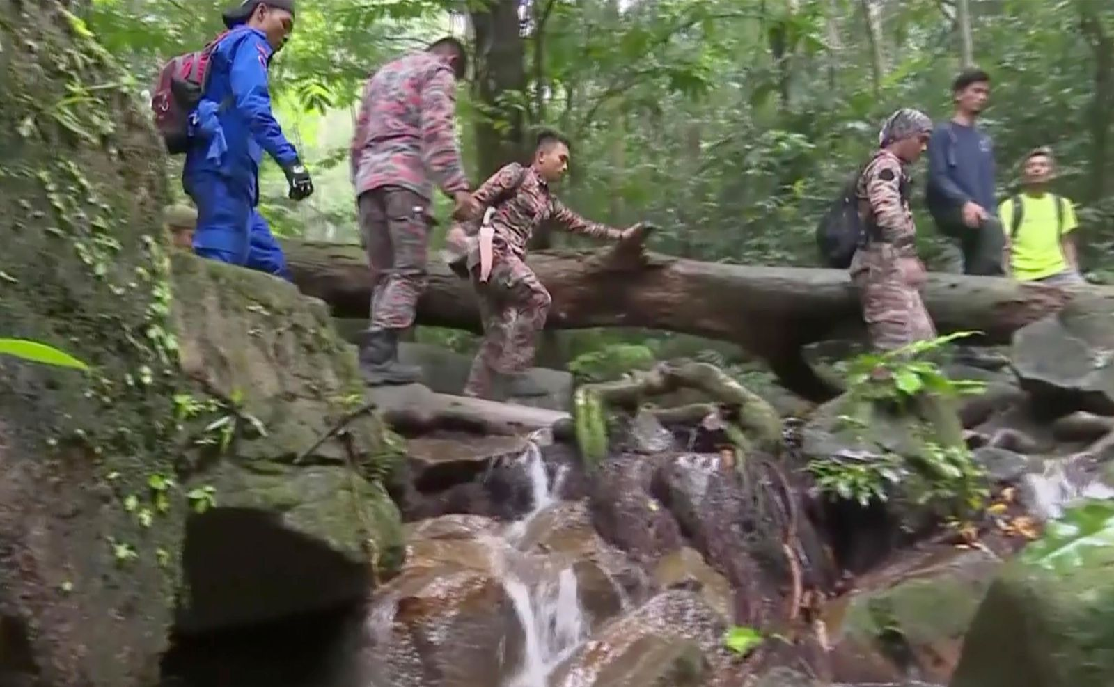 In this image from a video, rescuers conduct a search and rescue operation for a missing British girl at a forest in Seremban, Malaysia Monday, Aug. 12, 2019.{ } (AP Photo)