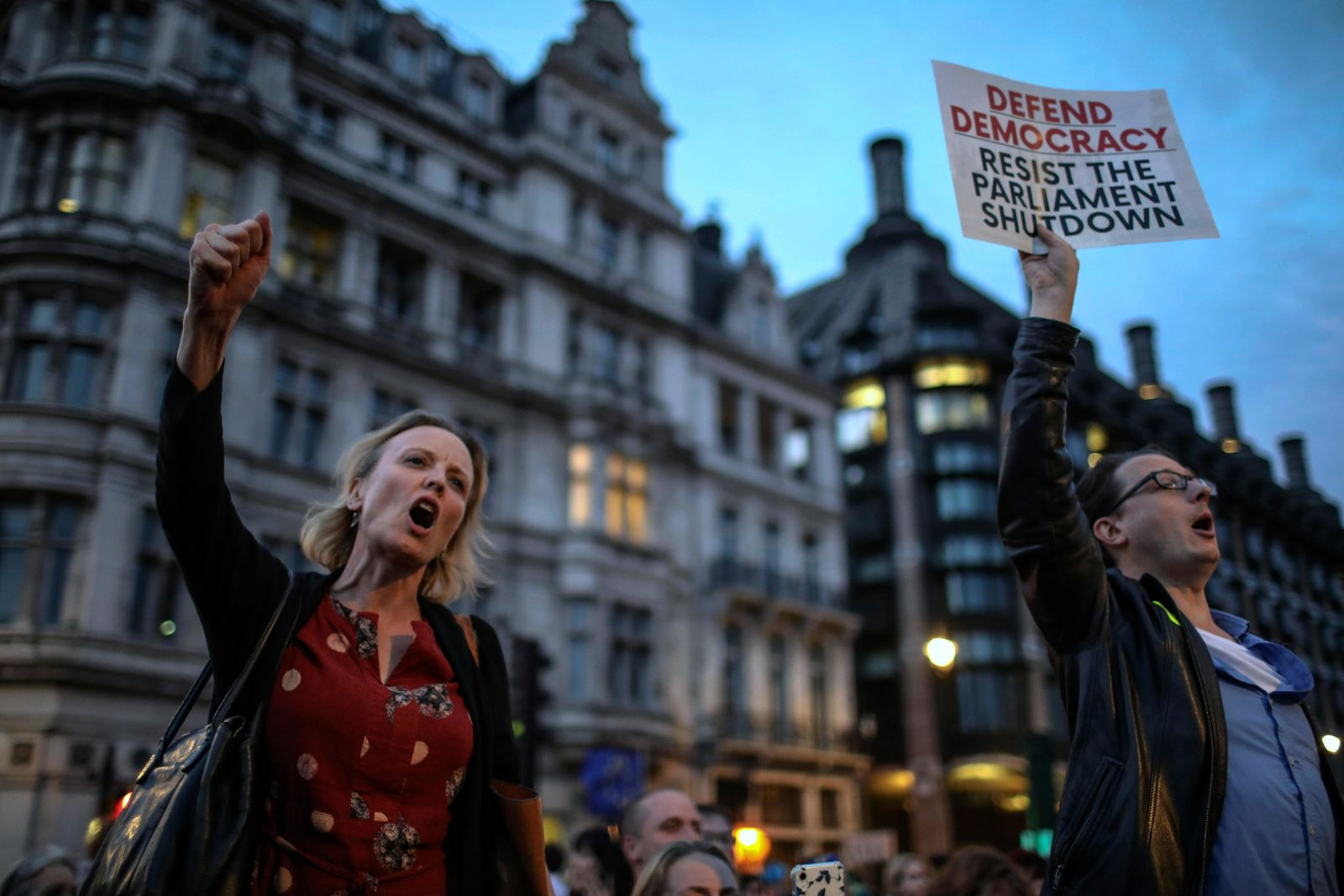 Anti-Brexit supporters take part in a protest in front of the Houses of Parliament in central London, Wednesday, Aug. 28, 2019. . (AP Photo/Vudi Xhymshiti)