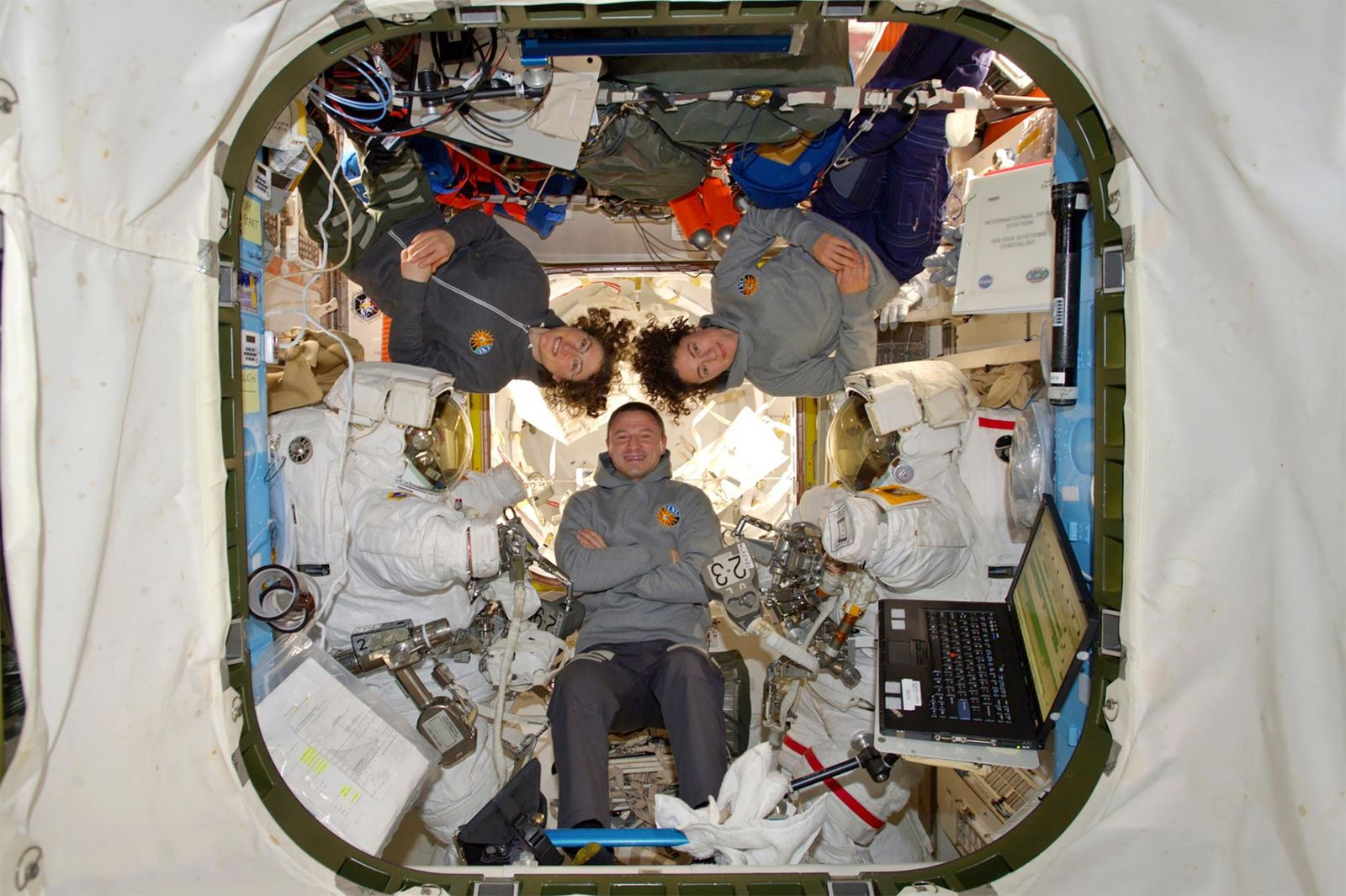 This photo provided by NASA shows astronauts Andrew Morgan with Christina Koch and Jessica Meir at the International Space Station on Friday, Oct. 18, 2019.  The world's first female spacewalking team made history high above Earth on Friday, floating out of the International Space Station to fix a broken part of the power network. As Koch and Meir emerged one by one, it marked the first time in a half-century of spacewalking that a woman floated out without a male crewmate.  (NASA via AP)