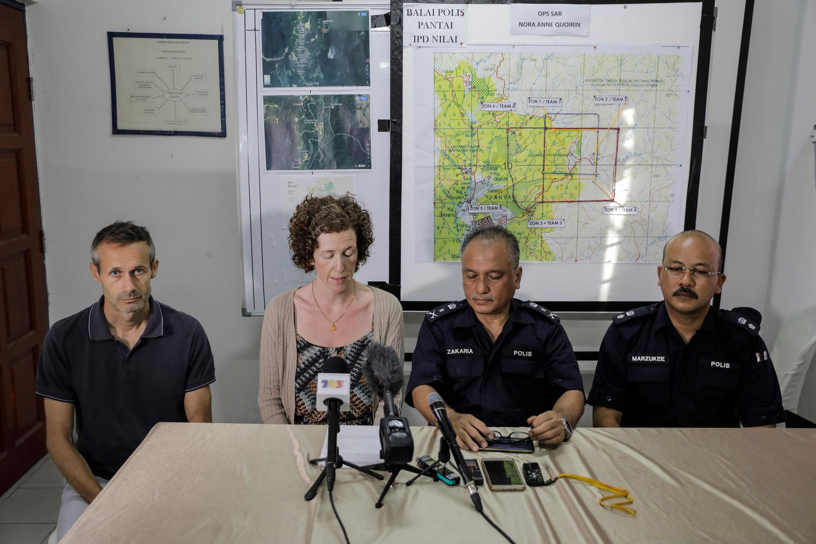 Meabh Quoirin, mother of missing schoolgirl Nora Anne Quoirin, reads a statement at a news conference in Seremban, Malaysia Monday, Aug. 12, 2019.(AP Photo)