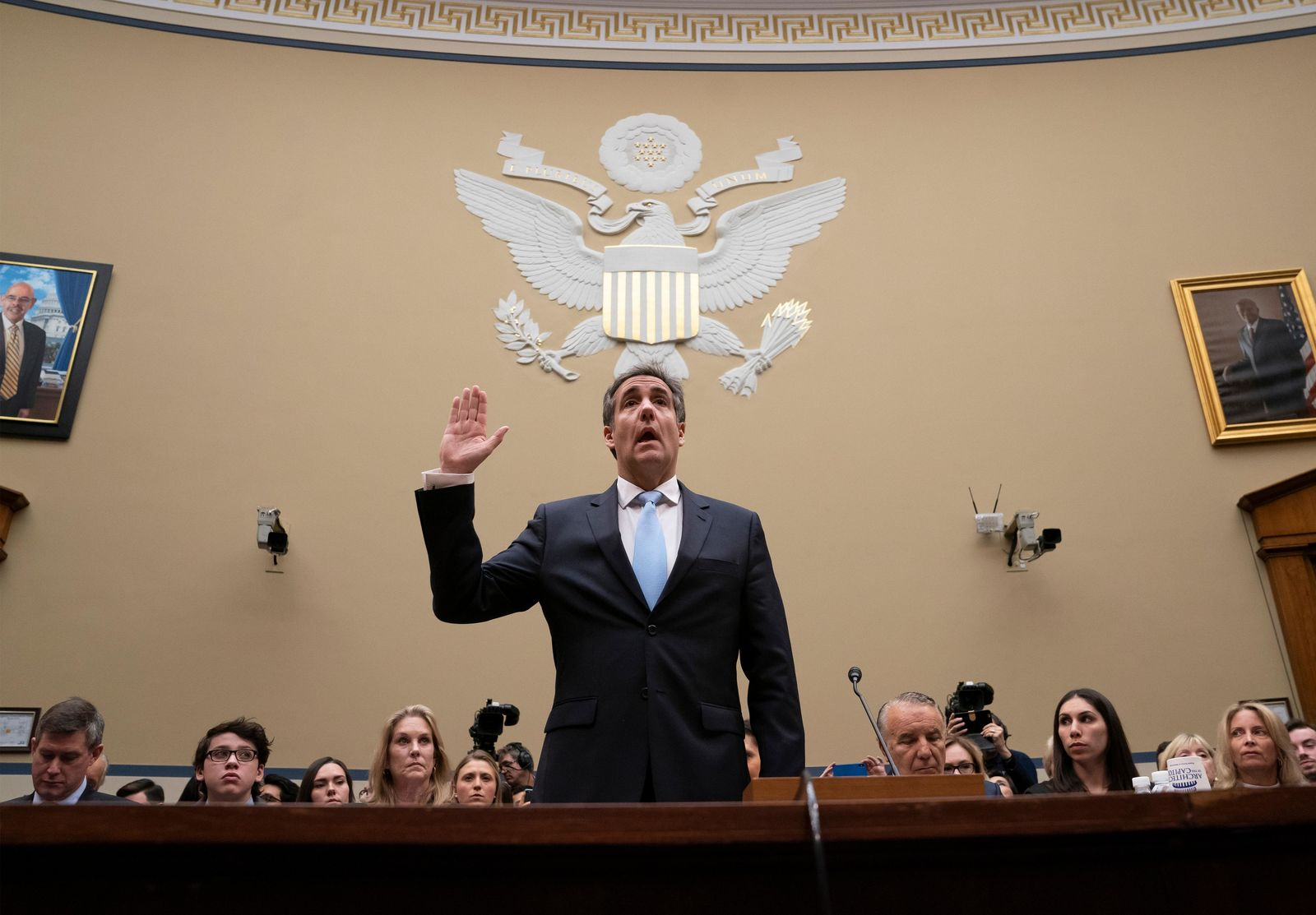 FILE- In this Feb. 27, 2019 file photo, Michael Cohen, President Donald Trump's former personal lawyer, is sworn in to testify before the House Oversight and Reform Committee on Capitol Hill in Washington. (AP Photo/J. Scott Applewhite, File)