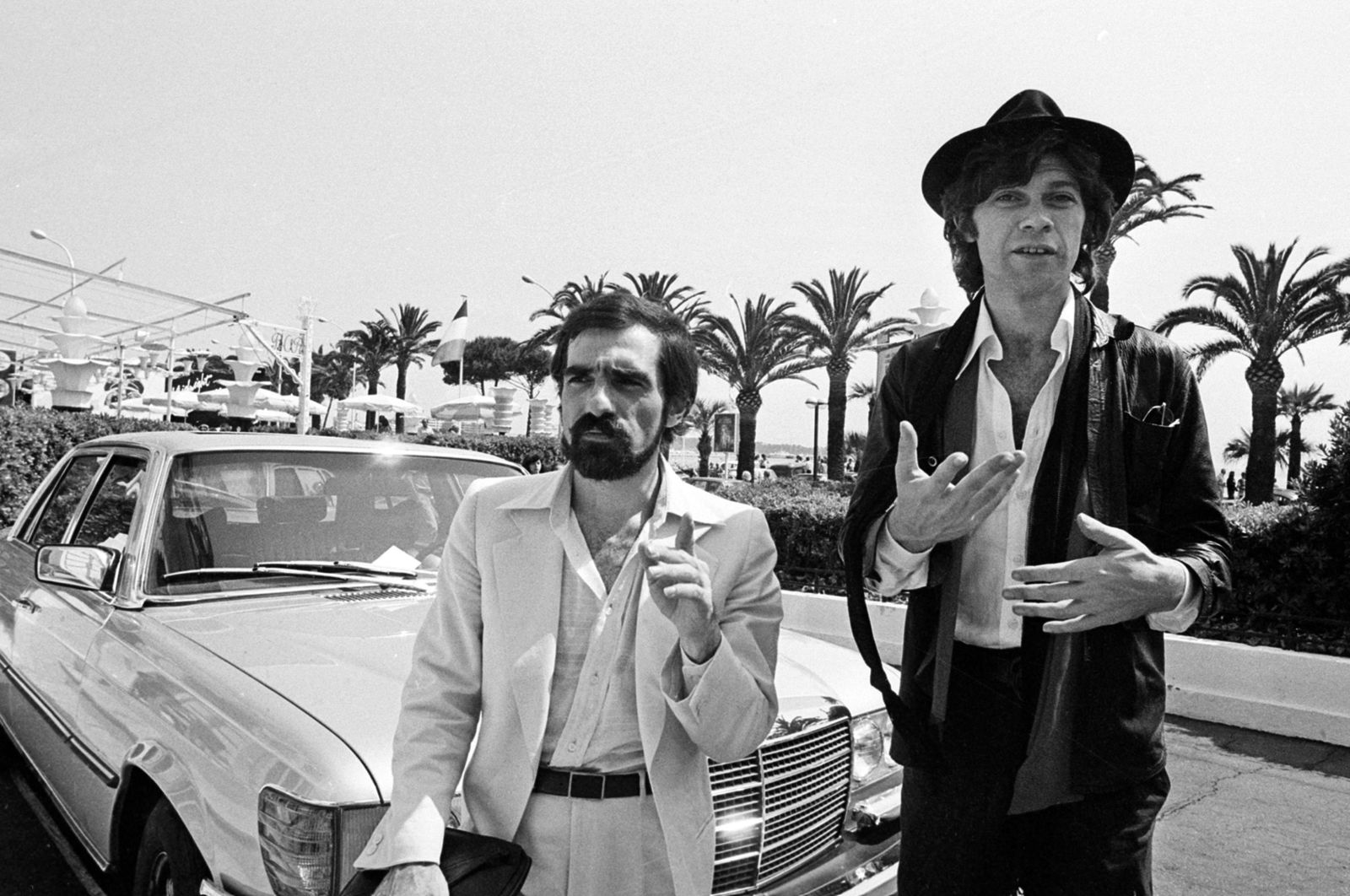 "FILE - In this May 29, 1978 file photo, Robbie Robertson, right, a Canadian guitarist of Mohawk ancestry, stands next to American director Martin Scorsese, left, before they presented the film ""Last Waltz,"" a film about Robertson's band, at the 31st Cannes International Film Festival. ""RUMBLE: The Indians Who Rocked the World,"" a new PBS Independent Lens documentary set to air Monday, Jan 21, 2019, shows how Native Americans laid the foundations to rock, blues and jazz. (AP Photo, File)"