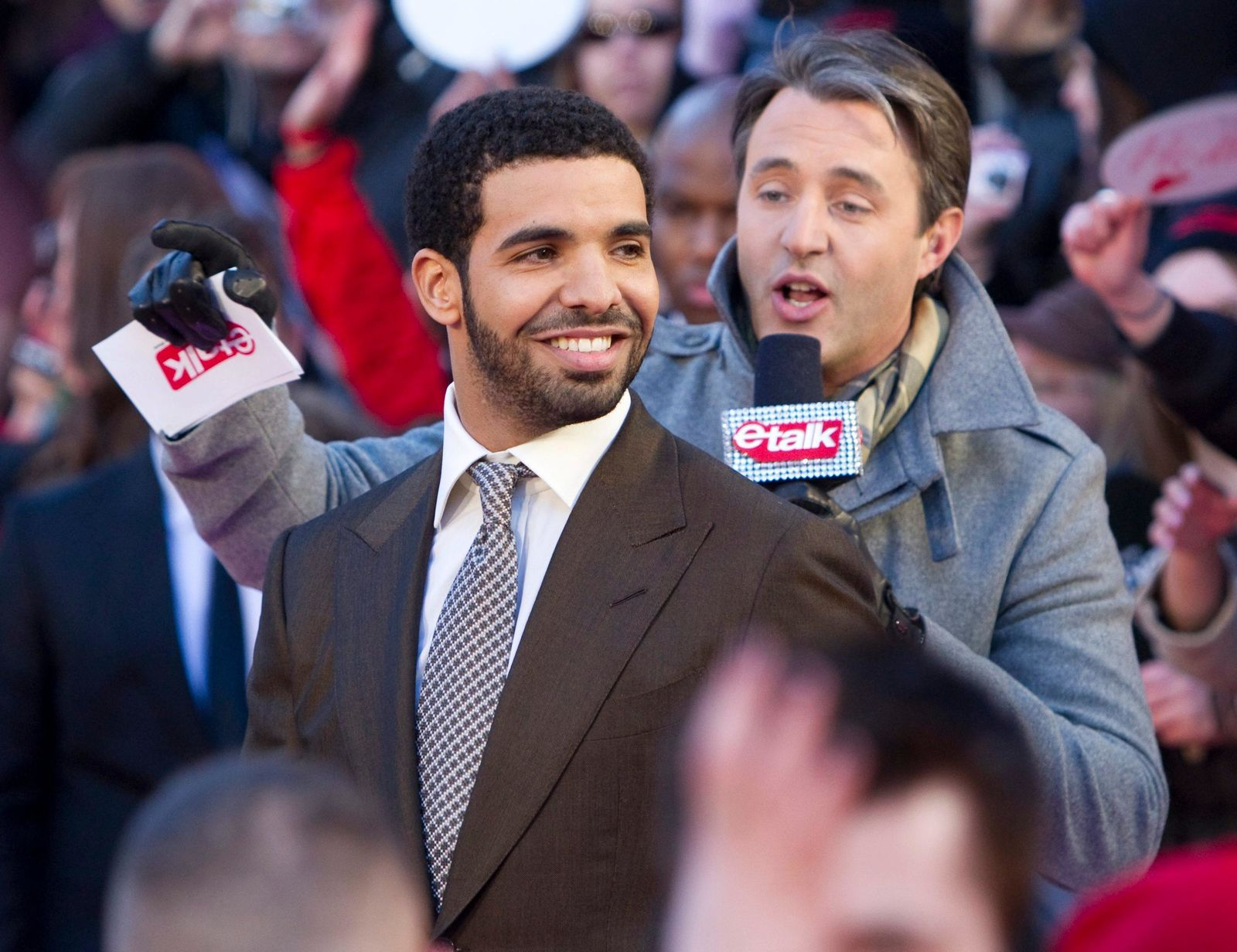 In this March 27, 2011 file photo, Drake arrives on the red carpet at the 2011 JUNO Awards, Canada's music awards in Toronto. Drake claims rival rapper Pusha T used a blackface photo out of context.{ } (Darren Calabrese/The Canadian Press via AP)