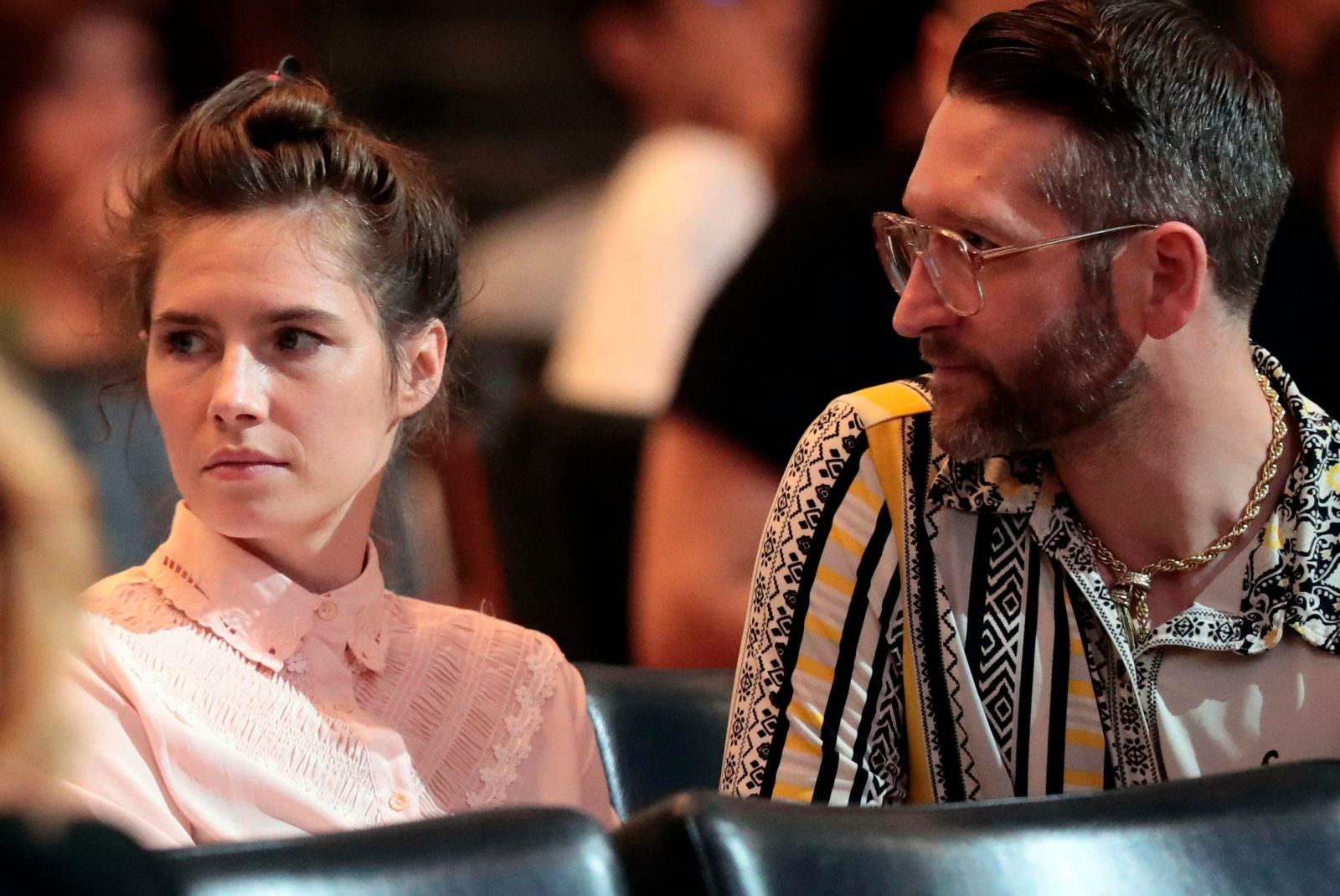 Amanda Knox and her fiancee Christopher Robinson attend a conference during a Criminal Justice Festival at the University of Modena, Italy, Friday, June, 2019. . (Elisabetta Baracchi/ANSA via AP)