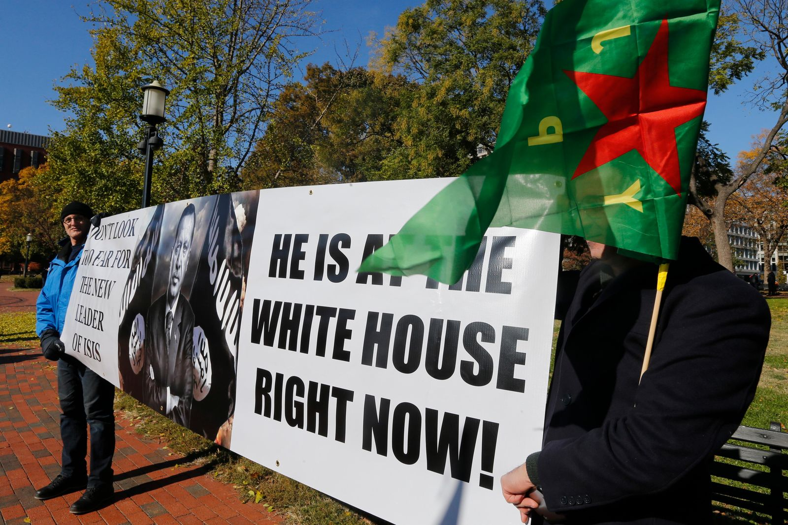 A small group of protesters hold signs as they prepare for a rally against Turkish President Recep Tayyip Erdogan at Lafayette Square park in front of the White House in Wednesday, Nov. 13, 2019, in Washington. (AP Photo/Steve Helber)