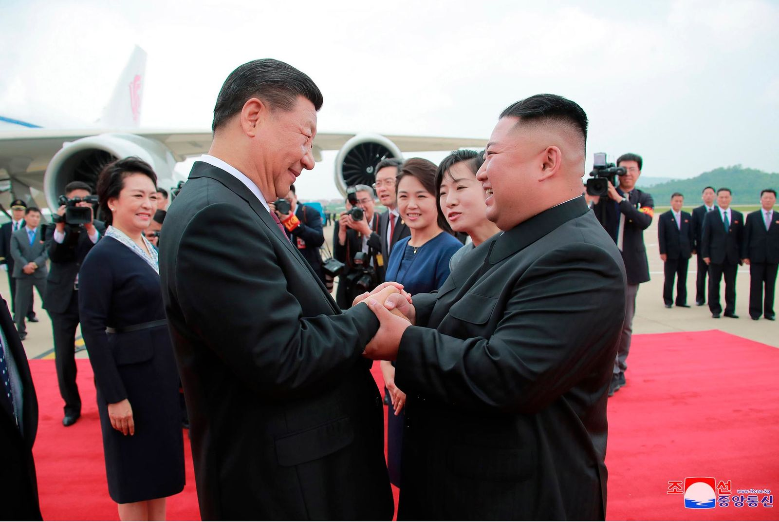 "In this Thursday, June 20, 2019, photo provided by the North Korean government, North Korean leader Kim Jong Un, right, shakes hands with Chinese President Xi Jinping at Pyongyang International Airport in Pyongyang, North Korea. The content of this image is as provided and cannot be independently verified. Korean language watermark on image as provided by source reads: ""KCNA"" which is the abbreviation for Korean Central News Agency. (Korean Central News Agency/Korea News Service via AP)"