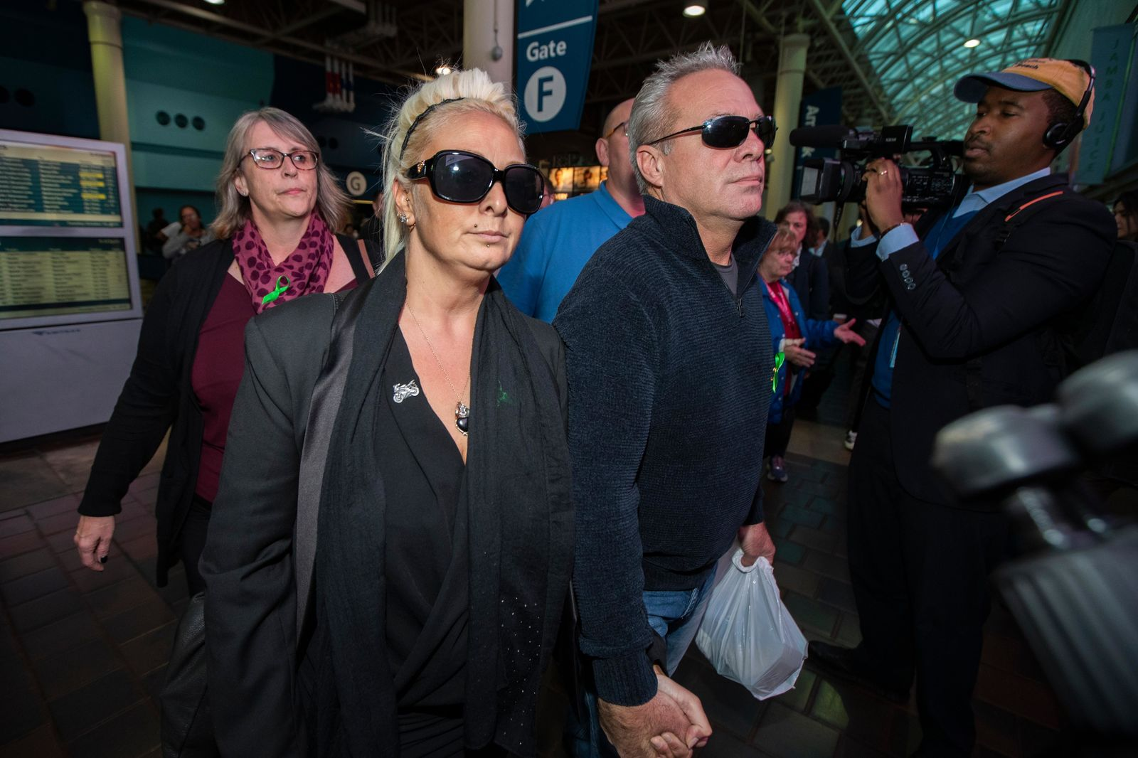 Charlotte Charles, left, mother of British teenager Harry Dunn, and her husband Bruce Charles, arrive at Union Station in Washington, Tuesday, Oct. 15, 2019. (AP Photo/Manuel Balce Ceneta)