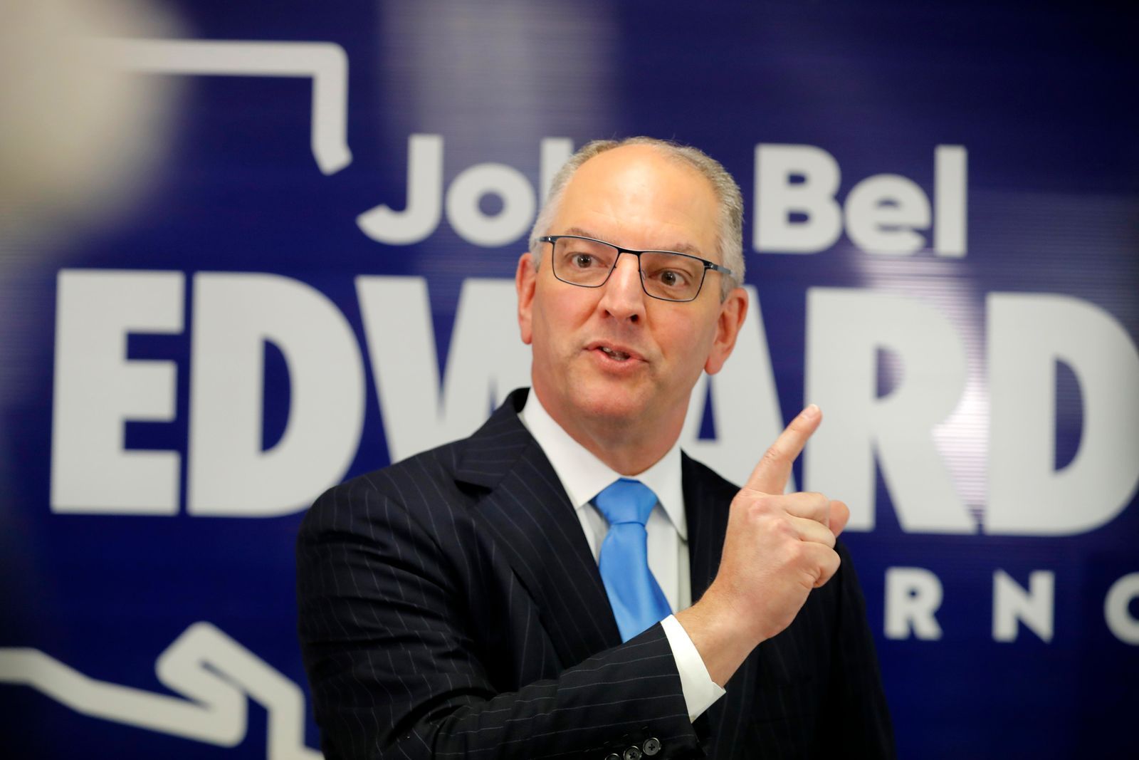 Louisiana Gov. John Bel Edwards talks to media at his campaign office in Shreveport, La., Thursday, Nov. 14, 2019. Edwards, a Democrat, was campaigning in the same metropolitan area his Republican challenger, Eddie Rispone, will be holding a campaign rally with President Donald Trump later in the evening. (AP Photo/Gerald Herbert)