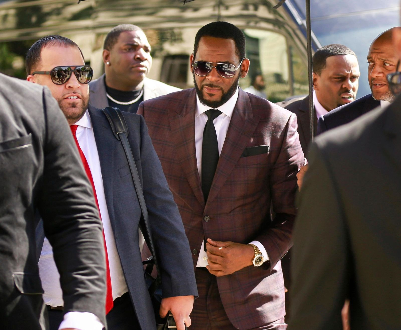 FILE - In this June 26, 2019, file photo, R&B singer R. Kelly, center, arrives at the Leighton Criminal Court building for an arraignment on sex-related felonies in Chicago. R. Kelly, already facing sexual abuse charges brought by Illinois prosecutors. (AP Photo/Amr Alfiky, File)