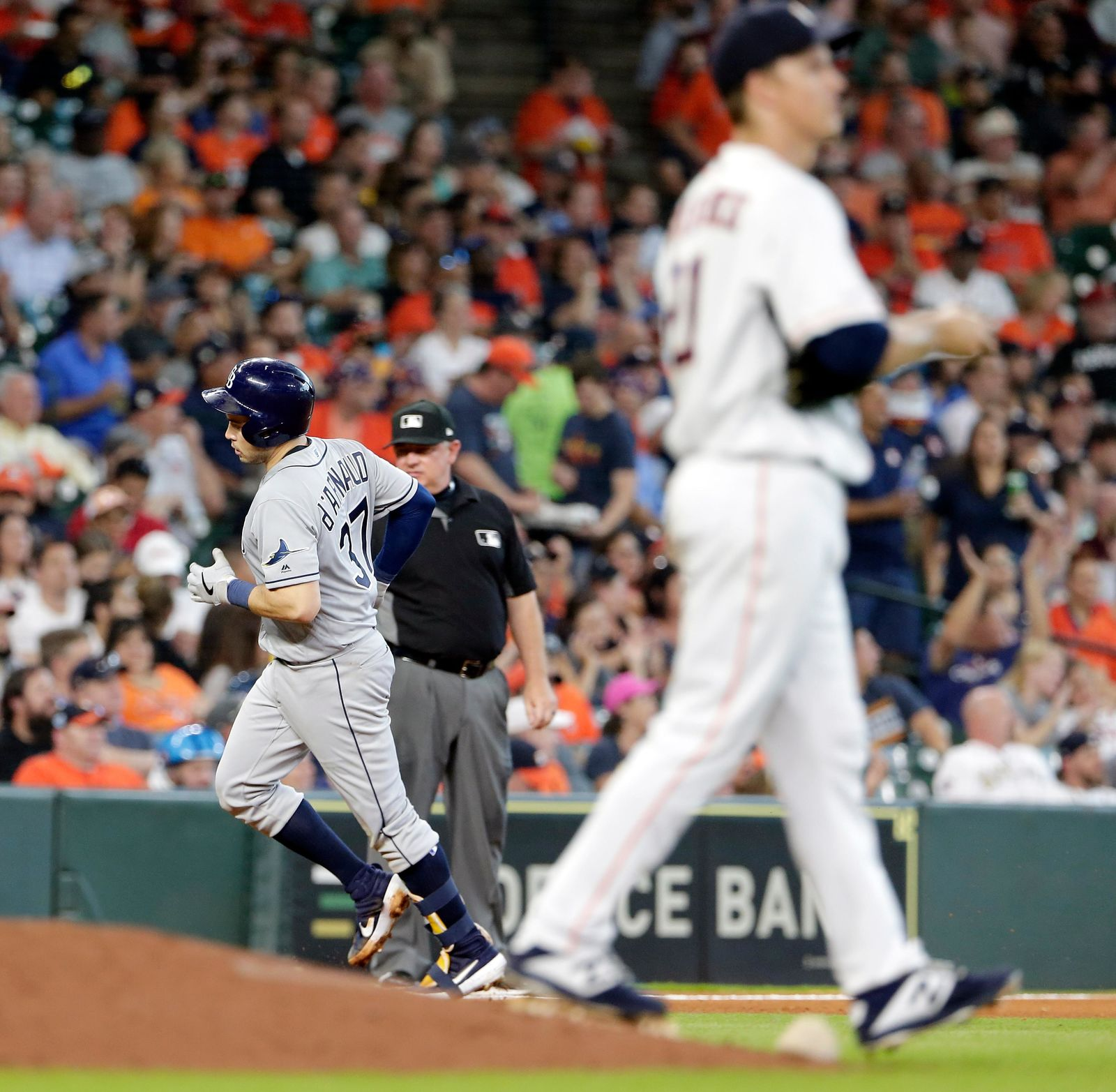 Tampa Bay Rays' Travis d'Arnaud (37) rounds the bases on his two run home run as Houston Astros starting pitcher Zack Greinke, right, walks off the mound during the fourth inning of a baseball game Thursday, Aug. 29, 2019, in Houston. (AP Photo/Michael Wyke)
