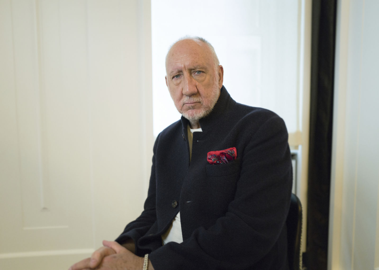 "This Oct. 31, 2019 photo shows author-singer Pete Townshend posing for a portrait in New York to promote his debut novel ""The Age of Anxiety."" Townshend, a member of the British rock band The Who, said the band plans to return to Cincinnati for the first time since the 1979 tragedy where 11 fans died in a frantic stampede at their concert. (Photo by Matt Licari/Invision/AP)"