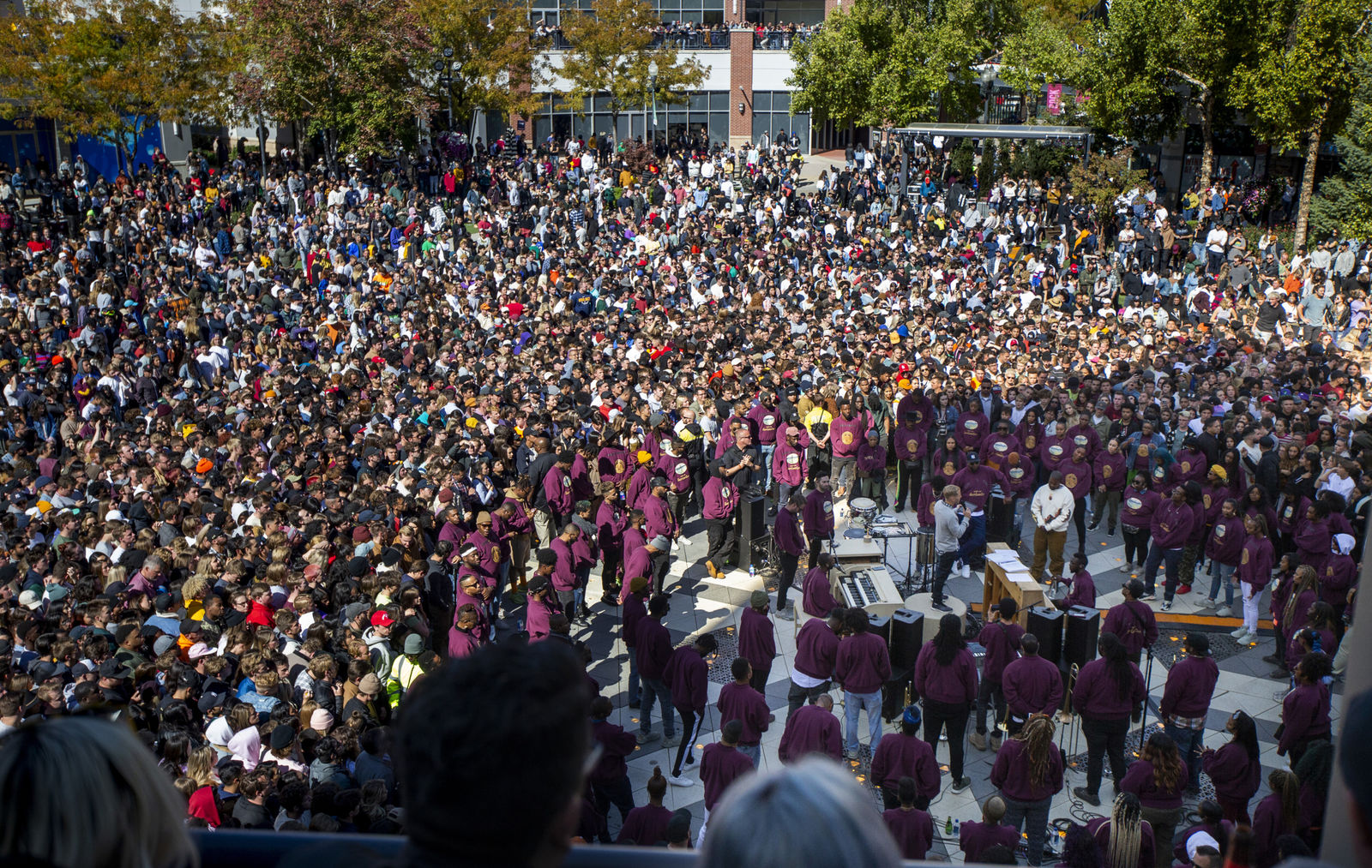 "Thousands pack into The Gateway in Salt Lake City for Kanye West's ""Sunday Service,"" Saturday, Oct. 5, 2019. People were standing on and climbing up anything they could find to catch a glimpse of West. West can be seen in the bottom right wearing a white sweatshirt. (Colter Peterson/The Deseret News via AP)"