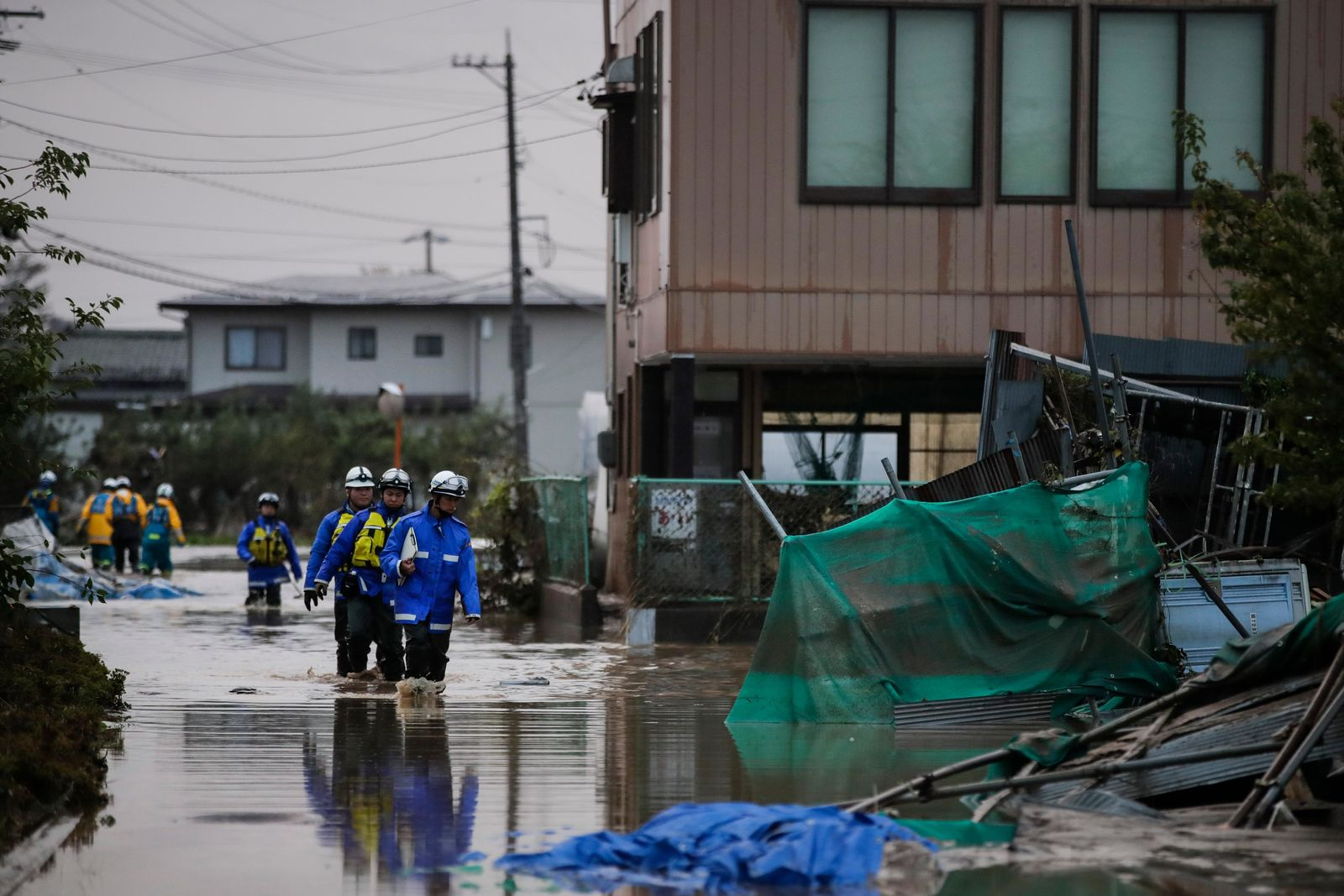 Search and rescue team members wade through floodwaters Monday, Oct. 14, 2019, in Hoyasu, Japan.{ } (AP Photo/Jae C. Hong)