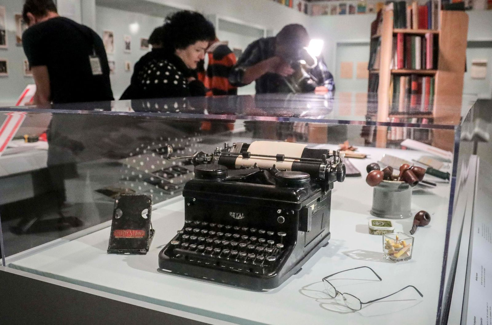 A typewriter, tobacco pipes, and eye glasses are part of a J.D. Salinger exhibit being installed at the New York Public Library, Wednesday, Oct. 16, 2019, in New York.{ } (AP Photo/Bebeto Matthews)