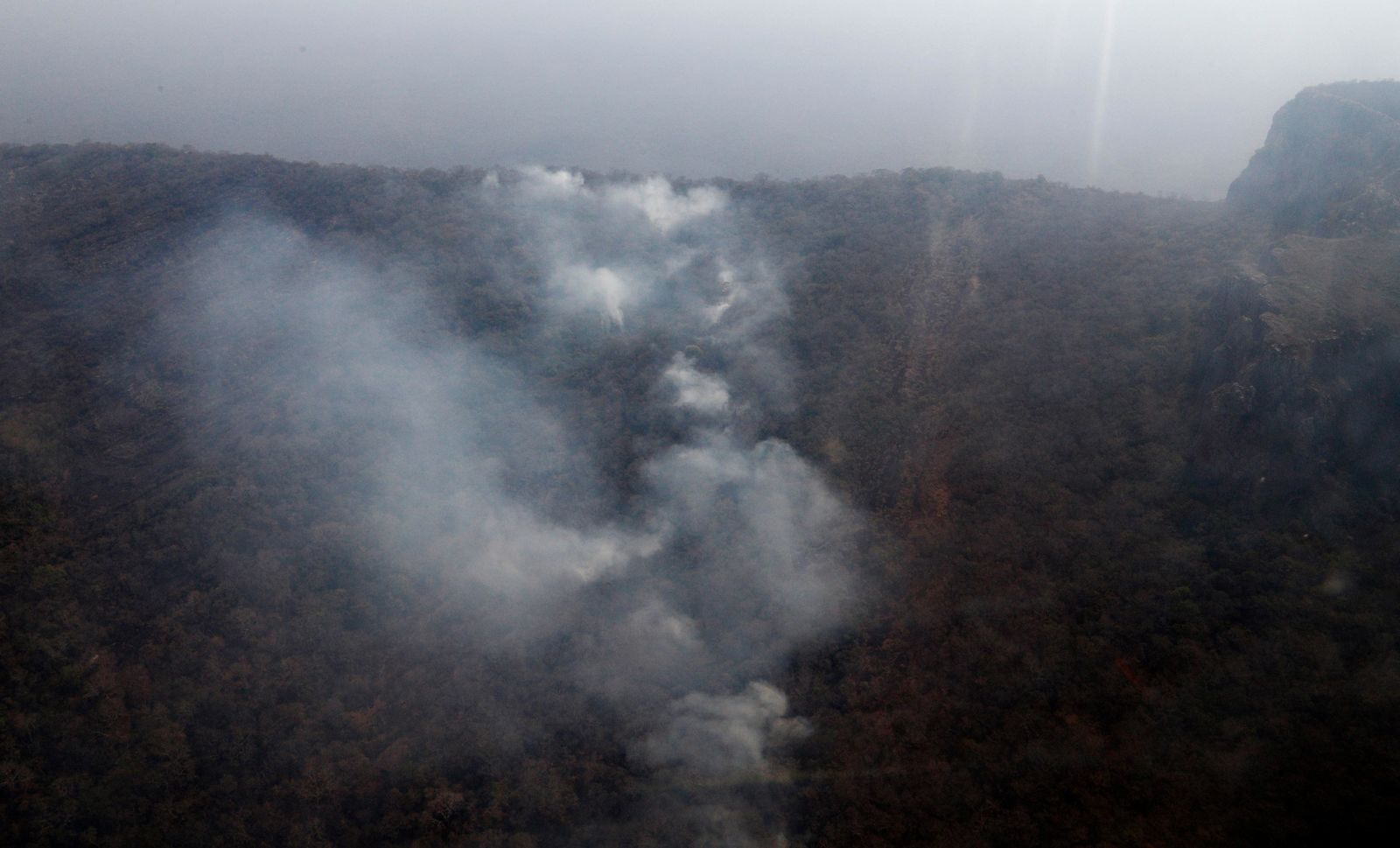 Wildfires burn in the Chquitania Forest near Robore, Bolivia, Sunday, Aug. 25, 2019. Bolivian President Evo Morales said Saturday he would welcome aid in fighting his country's wildfires, which have scorched more than 2,900 square miles (744,000 hectares) of land in the Chiquitanía region over the past two weeks. (AP Photo/Juan Karita)