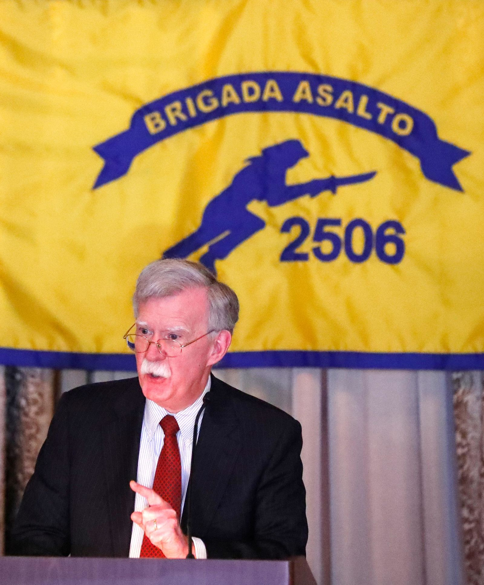 National security adviser John Bolton gestures while discussing administration new policy during a speech, Wednesday, April 17, 2019, in Coral Gables, Fla. (AP Photo/Wilfredo Lee)