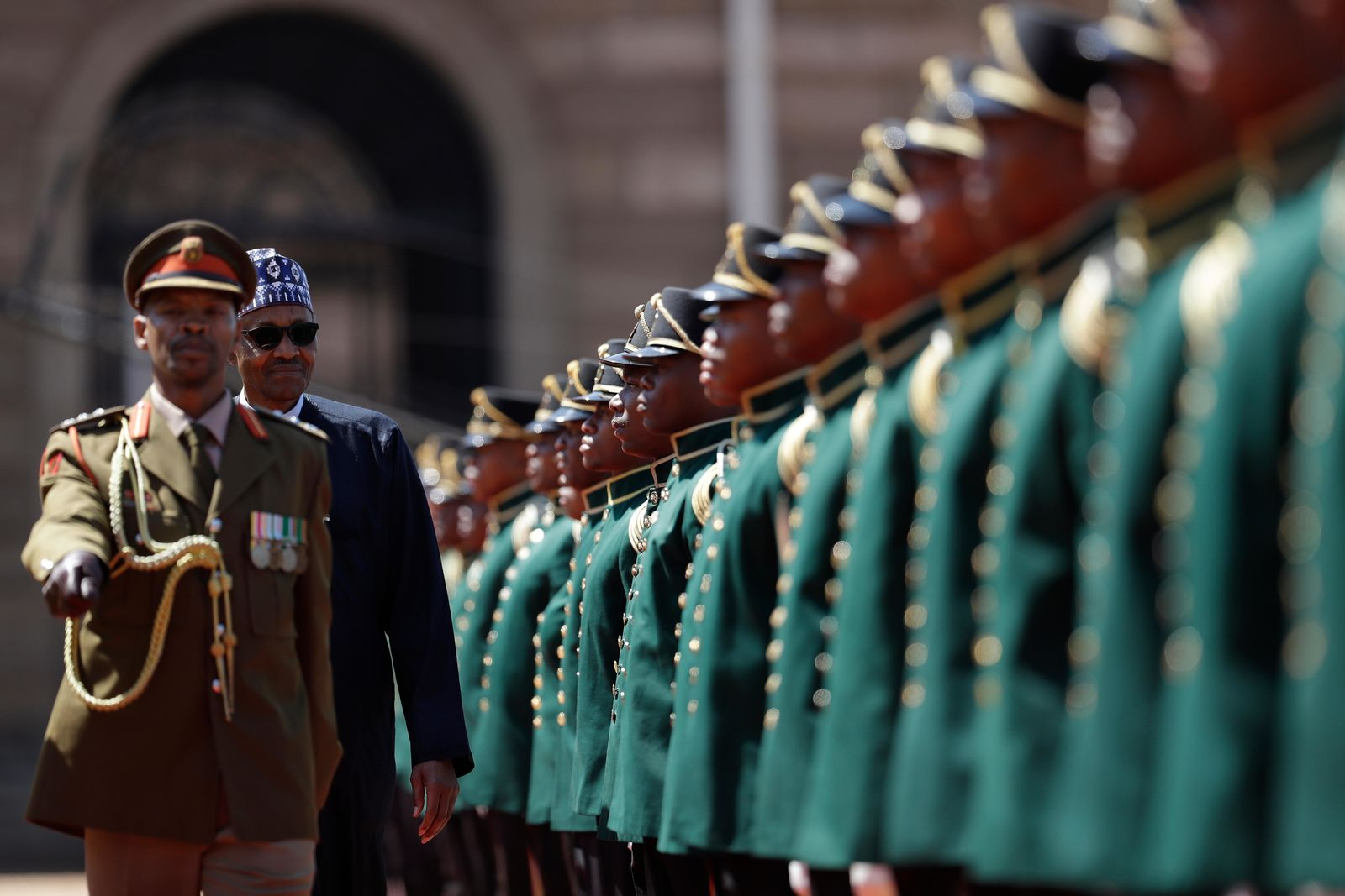 Nigerian President Muhammadu Buhari inspects a guard of honour at a welcoming ceremony in Pretoria, South Africa Thursday, Oct.3, 2019.{ } (AP Photo/Themba Hadebe)