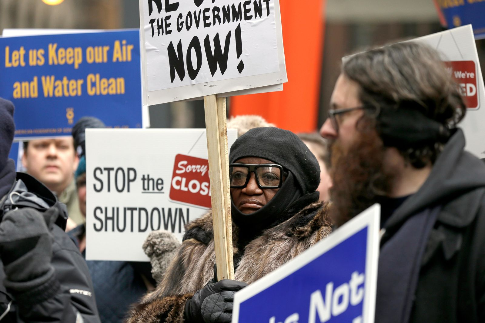 Government workers rally against the partial government shutdown at Federal Plaza, Thursday, Jan. 10, 2019, in Chicago. The partial government shutdown continues to drag on with hundreds of thousands of federal workers off the job or working without pay as the border wall fight persists. (AP Photo/Kiichiro Sato)