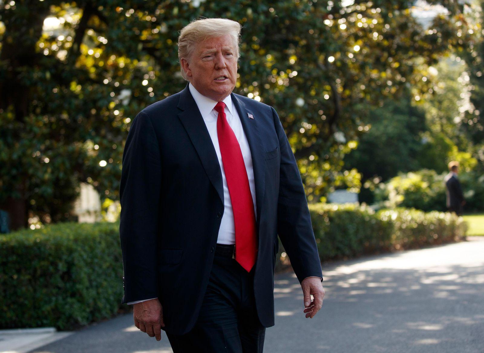 FILE - In this Thursday, May 30, 2019, file photo, President Donald Trump talks with reporters before departing on Marine One, in Washington. (AP Photo/Evan Vucci, File)