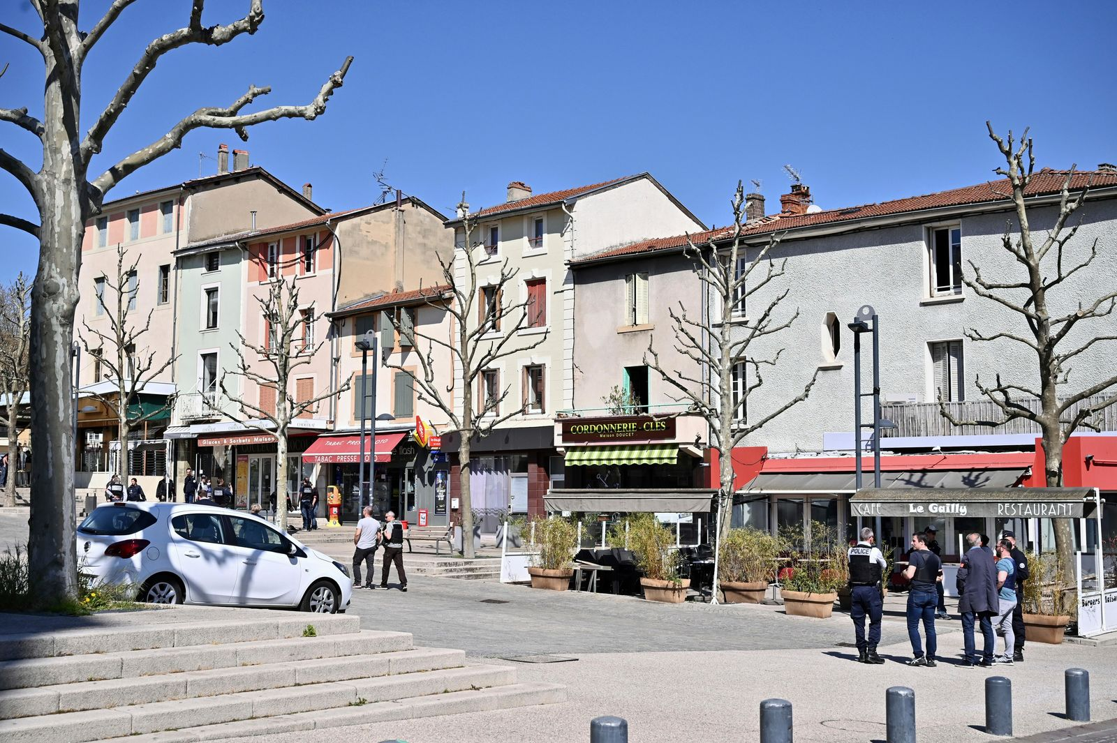 Police officers patrol after a man wielding a knife attacked residents venturing out to shop in the town under lockdown, Saturday April 4, 2020 in Romans-sur-Isere, southern France. (AP Photo)