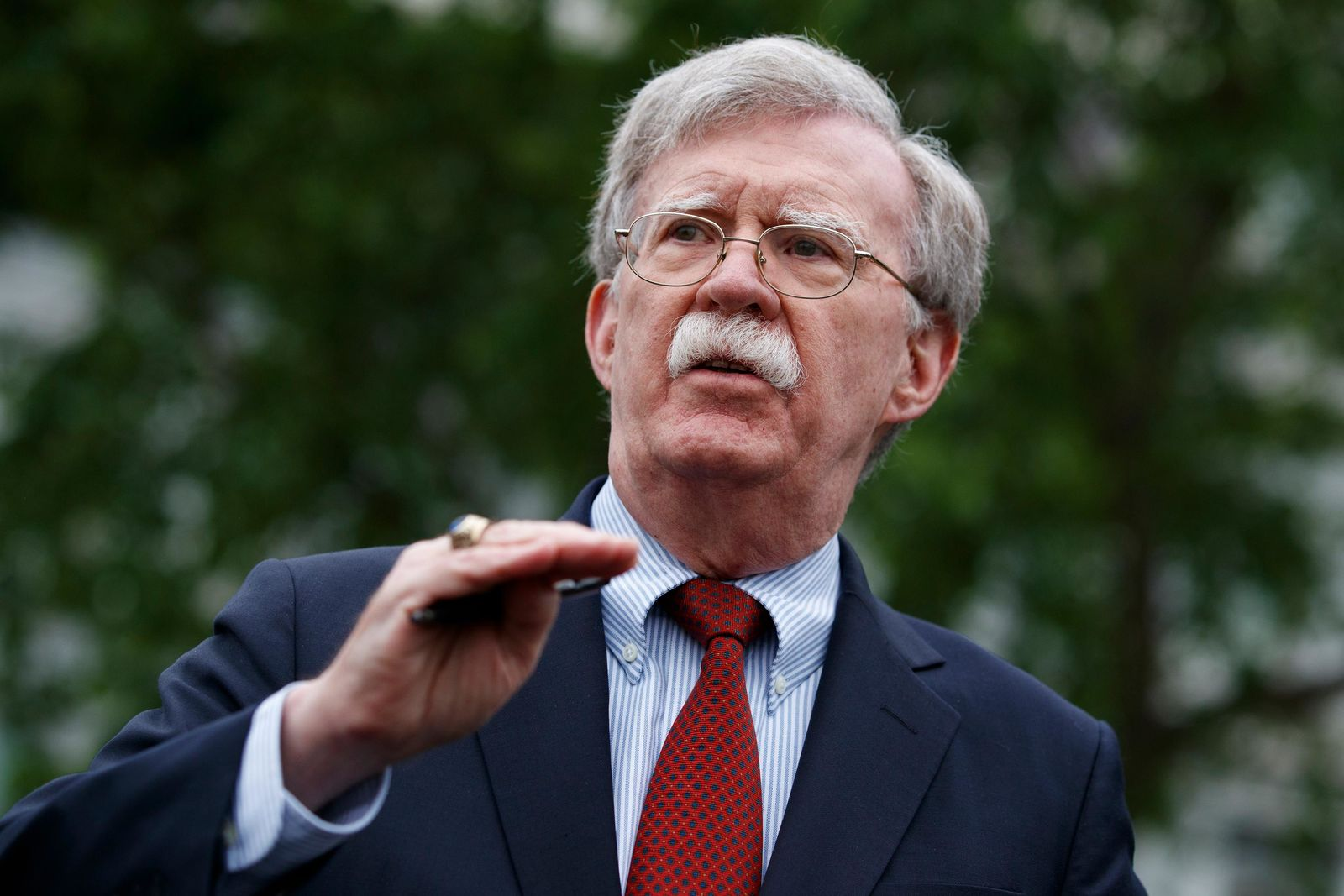 FILE - In this Wednesday, May 1, 2019 file photo, National Security Adviser John Bolton talks to reporters about Venezuela, outside the White House, in Washington.{ } (AP Photo/Evan Vucci, File)