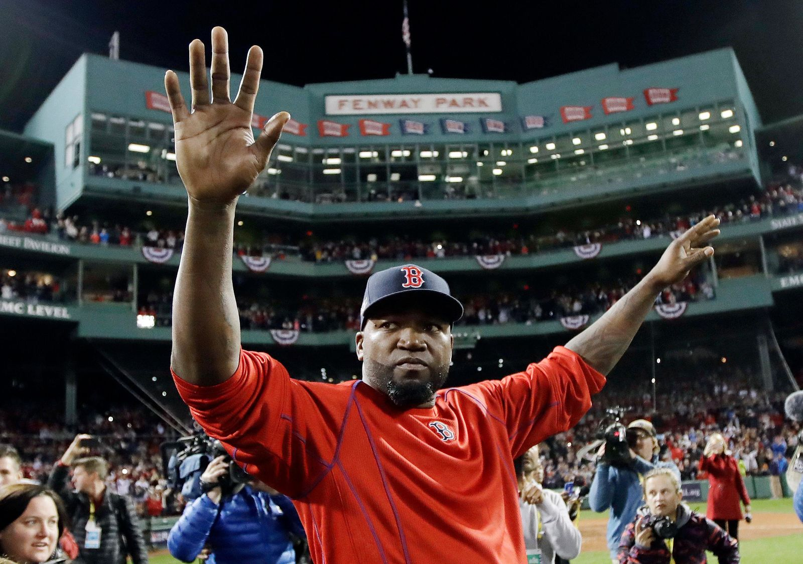 FILE - In this Oct. 10, 2016, file photo, Boston Red Sox's David Ortiz waves from the field at Fenway Park after Game 3 of baseball's American League Division Series against the Cleveland Indians in Boston.{ } (AP Photo/Charles Krupa, File)
