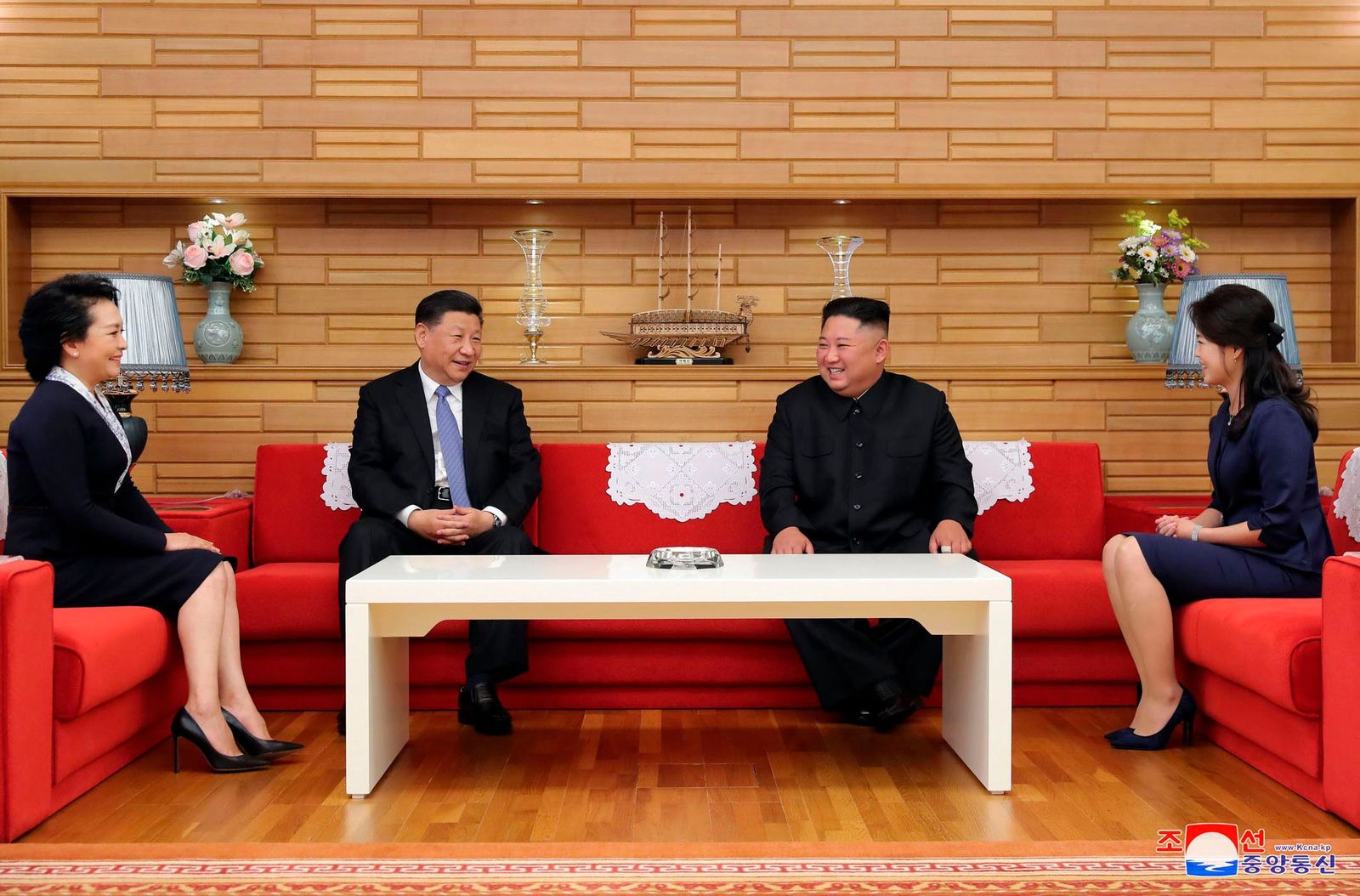"In this Thursday, June 20, 2019, photo provided by the North Korean government, North Korean leader Kim Jong Un, center right, and his wife Ri Sol Ju, right, meet Chinese President Xi Jinping, center left, and his wife Peng Liyuan at Kumsusan guest house in Pyongyang, North Korea. The content of this image is as provided and cannot be independently verified. Korean language watermark on image as provided by source reads: ""KCNA"" which is the abbreviation for Korean Central News Agency. (Korean Central News Agency/Korea News Service via AP)"