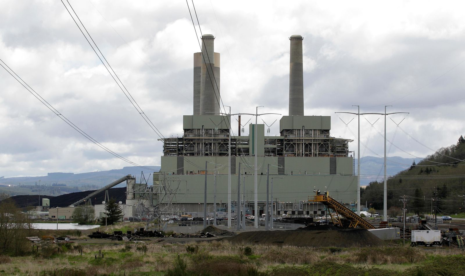 FILE - In this April 29, 2011, file photo, the coal-burning TransAlta power plant is shown near Centralia, Wash. (AP Photo/Ted S. Warren, File)