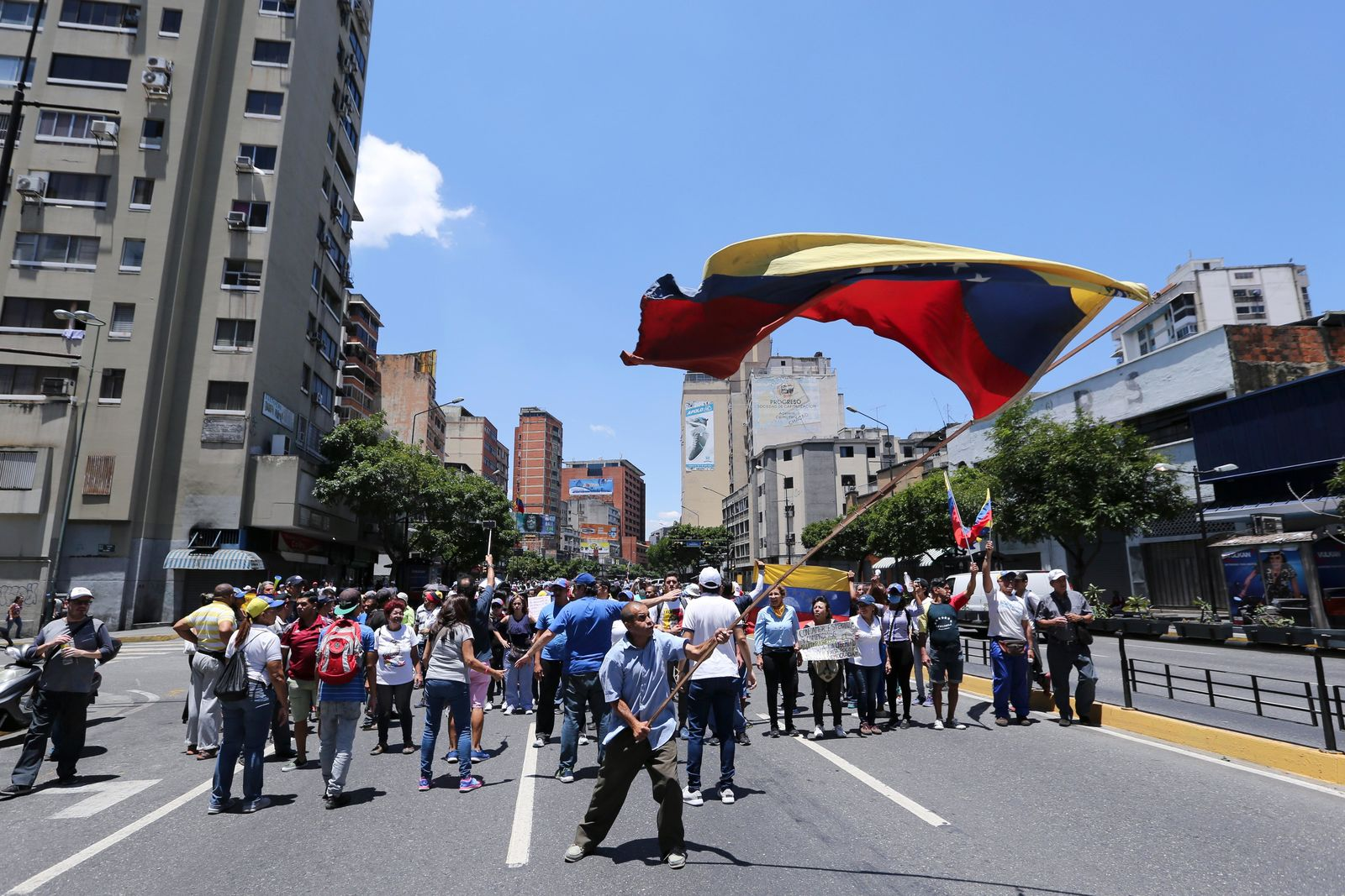 Supporters of opposition leader and self-proclaimed interim president Juan Guaido march to protest outages that left most of the country scrambling for days in the dark in Caracas, Venezuela, Saturday, April 6, 2019. (AP Photo/Fernando Llano)