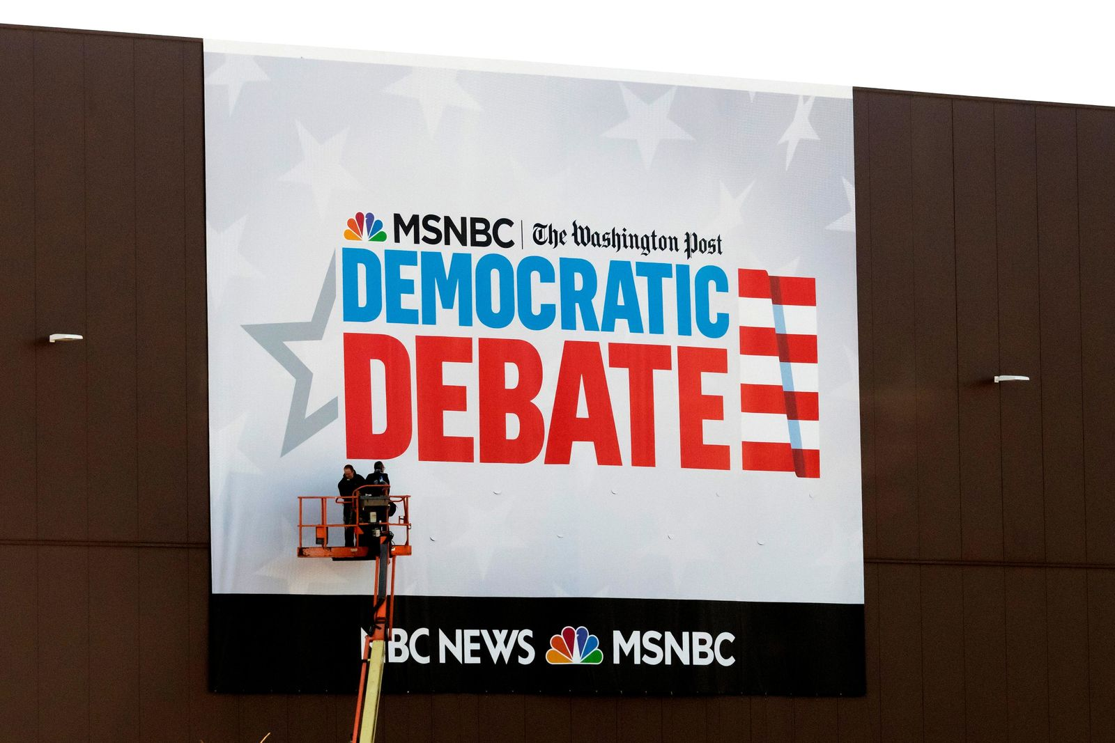 In this Tuesday, Nov. 19, 2019 photo, preparations for the Democratic presidential primary debate are underway before Wednesday's debate in Atlanta. (AP Photo/John Amis)